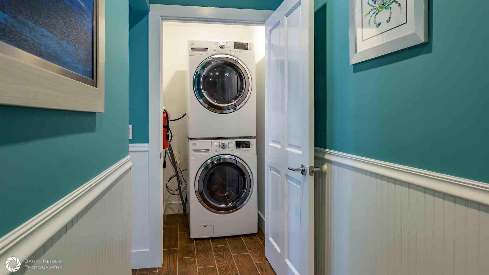 The laundry closet is located upstairs in the hall...
