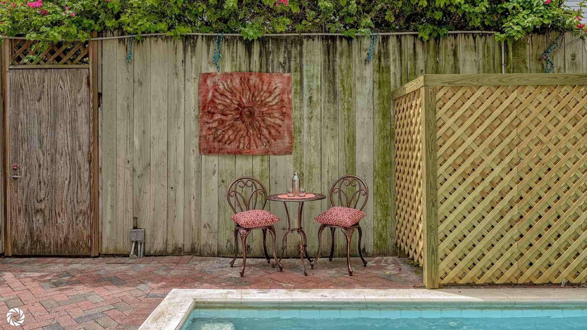 Pleasant outdoor artwork decorates the fence surrounding the pool area...