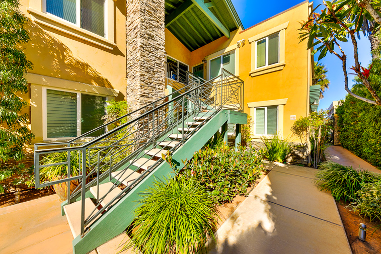 Beautiful staircase up to the entry of this seaside condo.