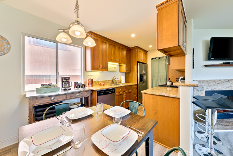 Updated kitchen with a dining nook makes it easy to create and serve meals and snacks anytime.