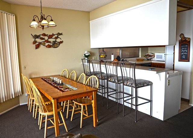Dining table with seating for 8 and additional kitchen counter bar seating for 4.