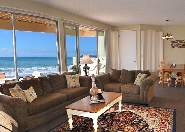 Enjoy indoor outdoor living as you feel the ocean breeze while sitting on the couch.