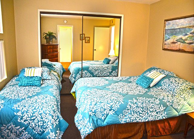 Alternate view of bedroom #3 with queen sized bed and twin sized bed.