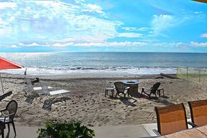 Beach front patio allows for you to enjoy both the beach and ocean during your stay.