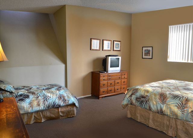 Alternate view of bedroom #2 with king size bed and twin sized bed.