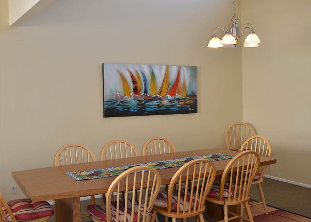 Alternate view of dining table with ample seating.