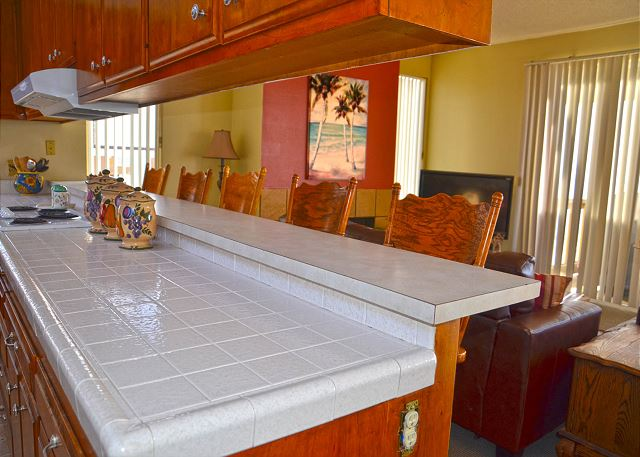 Kitchen counter top with additional bar seating for 5.