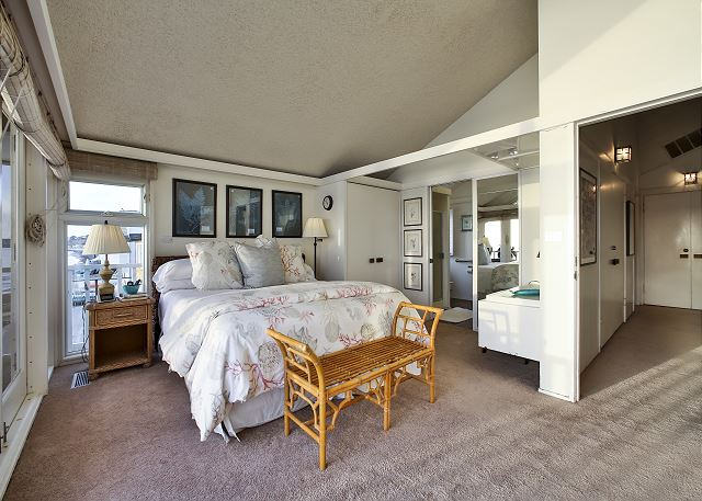View of master bedroom with in suite bathroom.