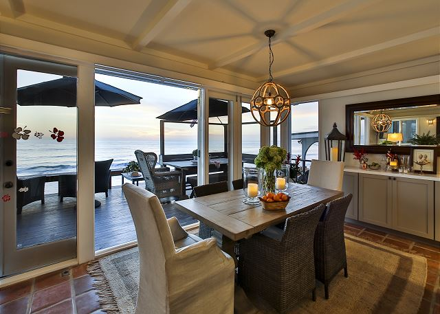 Enjoy the ocean breeze while dining at this table with seating for 6.