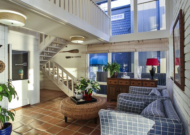 Additional view of living area and stairs to the second floor.