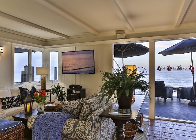 Wall mounted T.V. in family room compliments the ocean views over the patio.