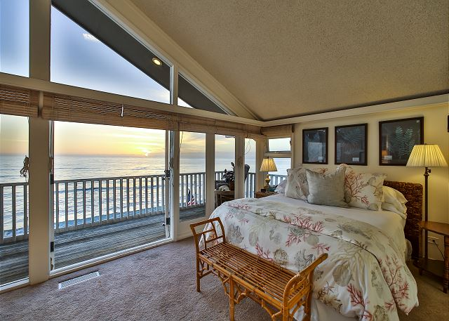 Master bedroom with king bed. Sweeping views of the Pacific Ocean can be enjoyed from inside the room or deck.