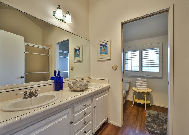 Bathroom with his and her sinks.