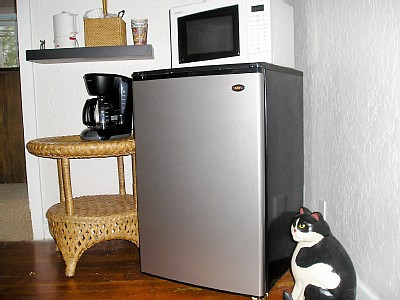 Refrigerator and coffeemaker in sitting room