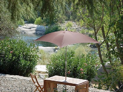 Tables and umbrellas invite guests outdoors.