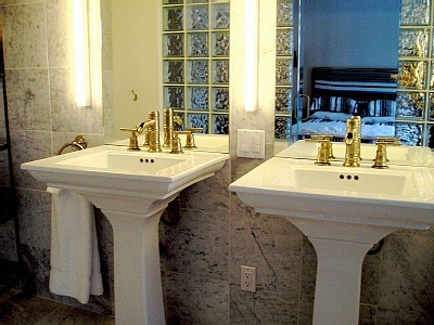 Twin sinks in the marble bathroom