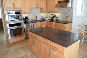 Beautiful kitchen with granite countertops and stainless steel appliances.