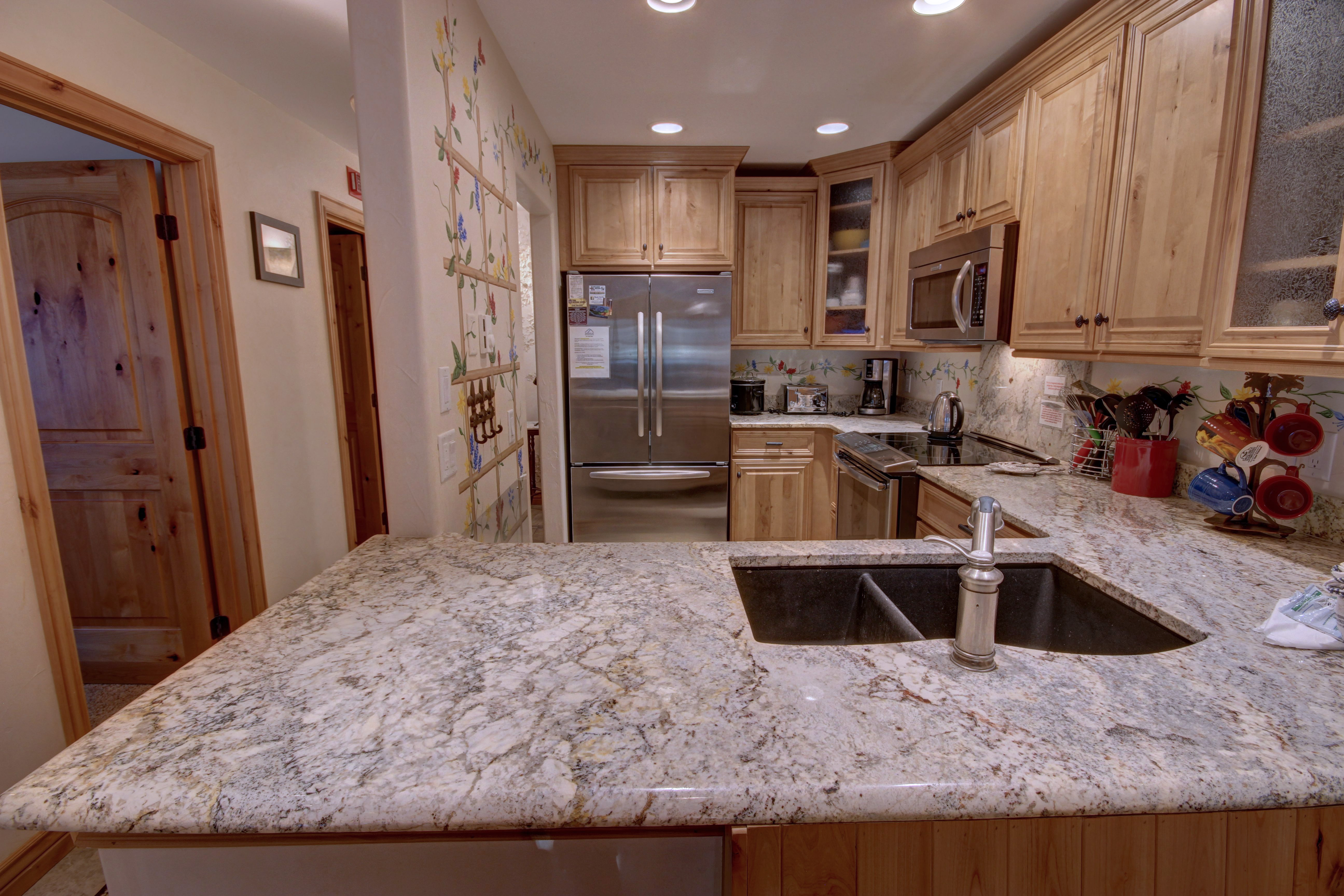 Kitchen with marble granite countertops