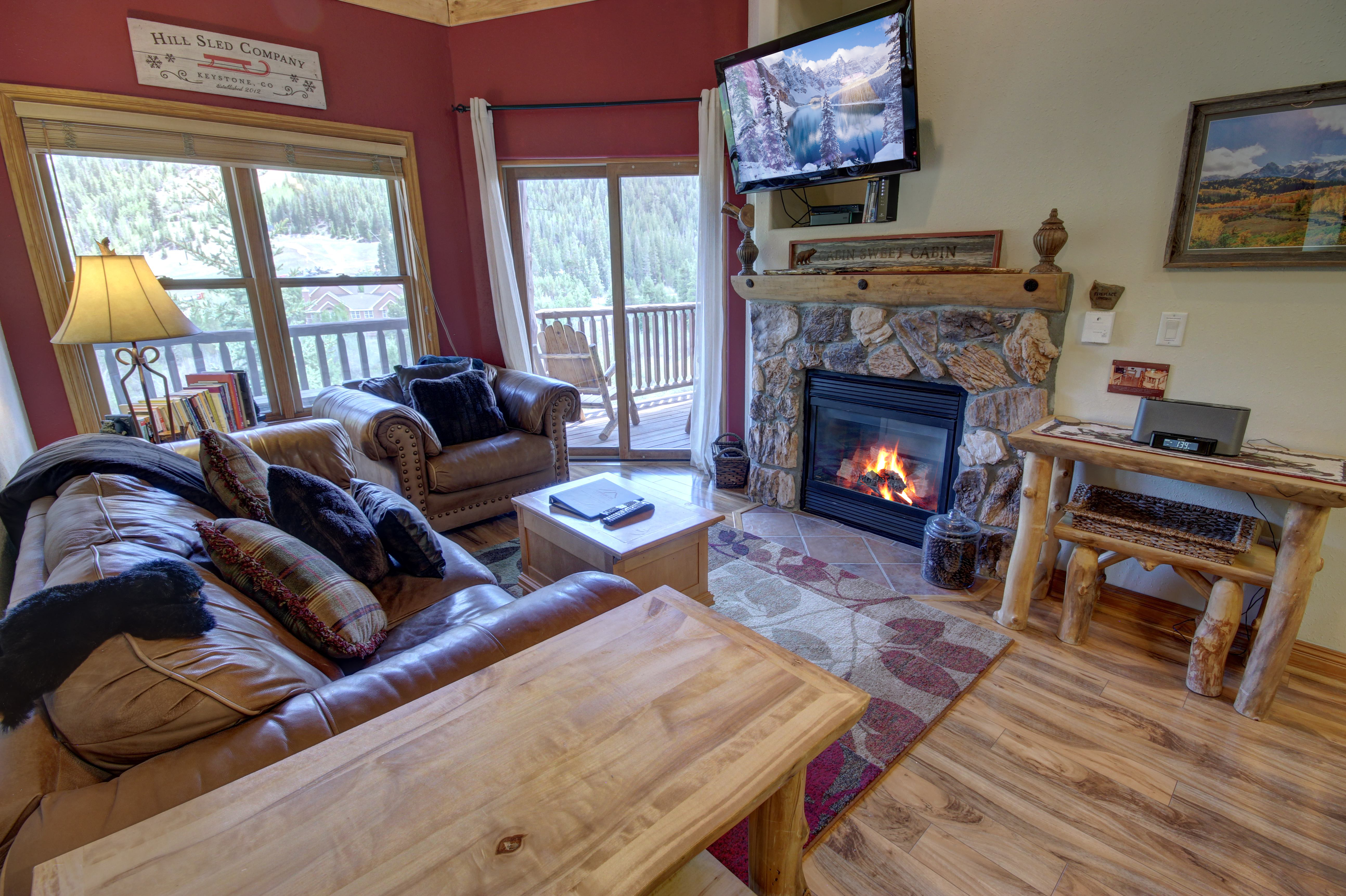 Living room with cozy fireplace and relaxing flatscreen TV