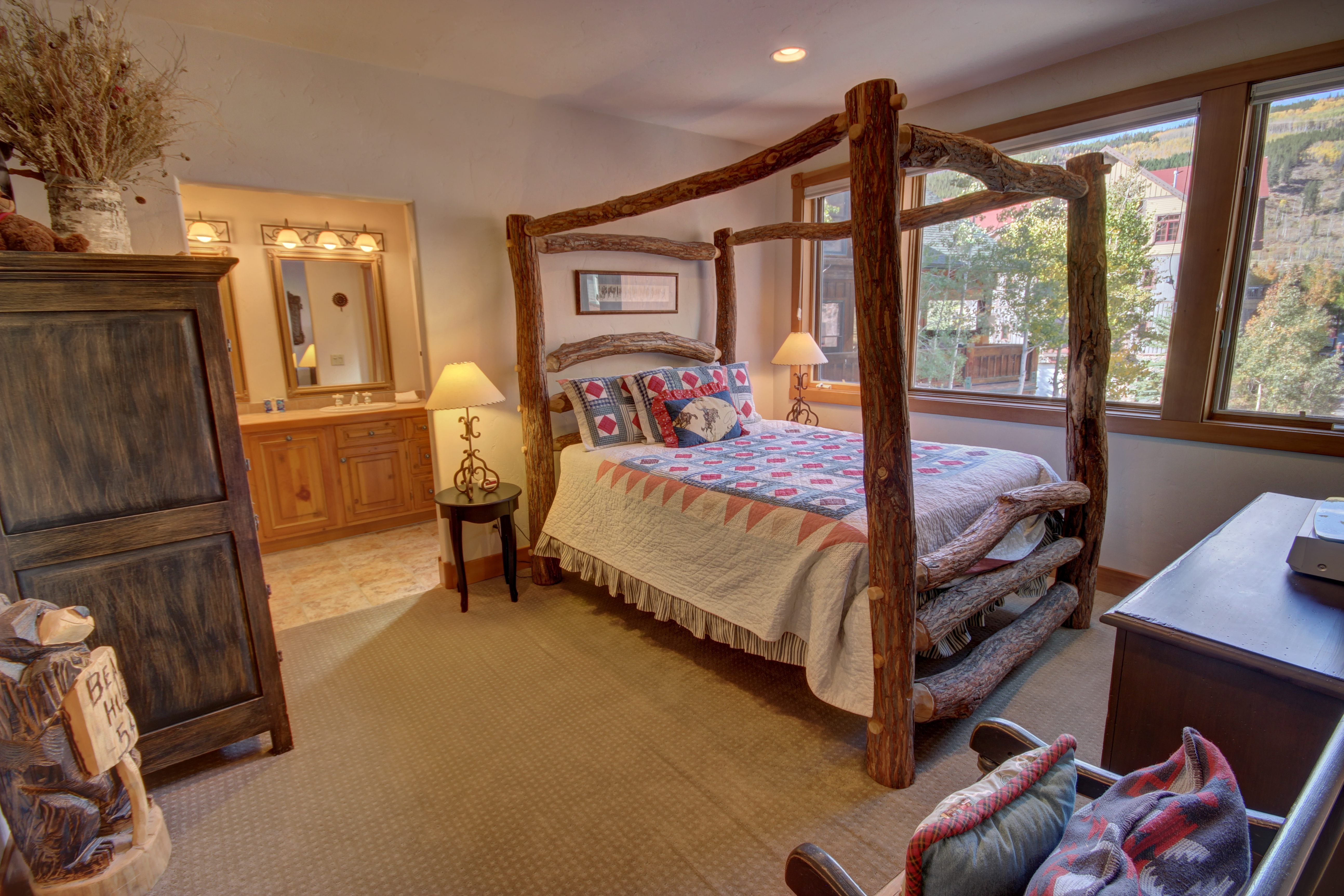 Bedroom with a 4- post canopy bed frame