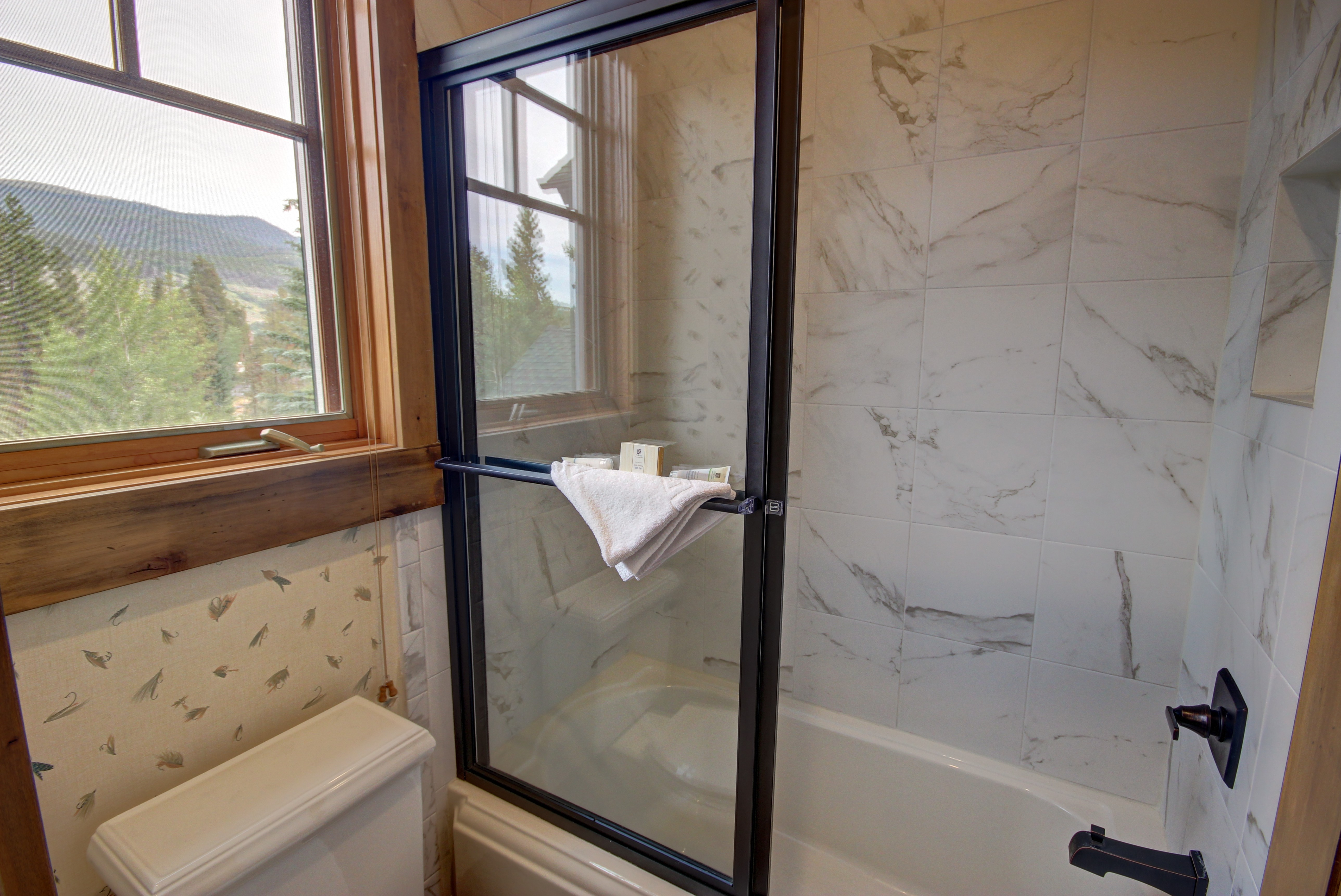 Bathroom with a relaxing tub and shower