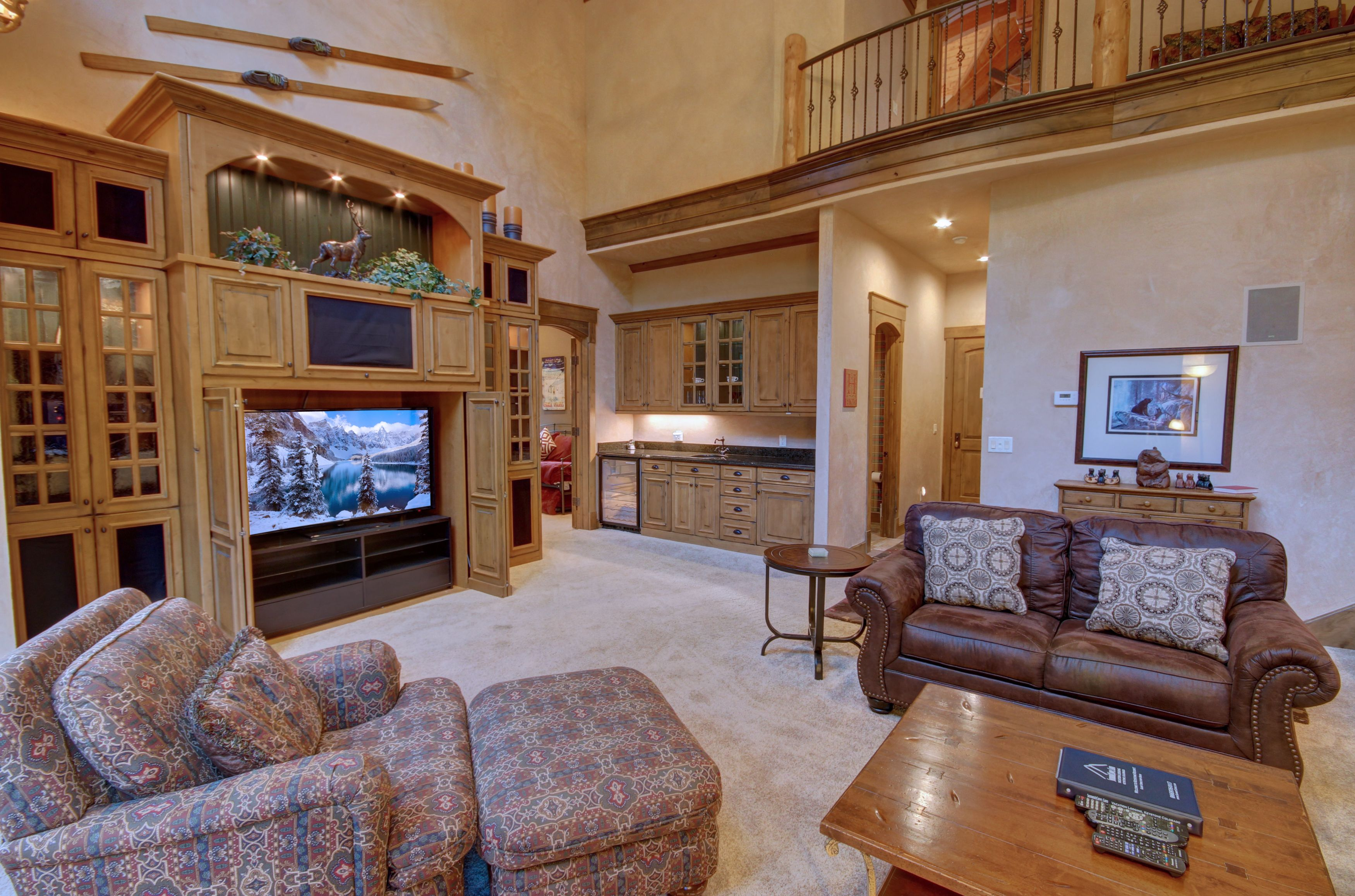 living room with comfy couches and relaxing tv