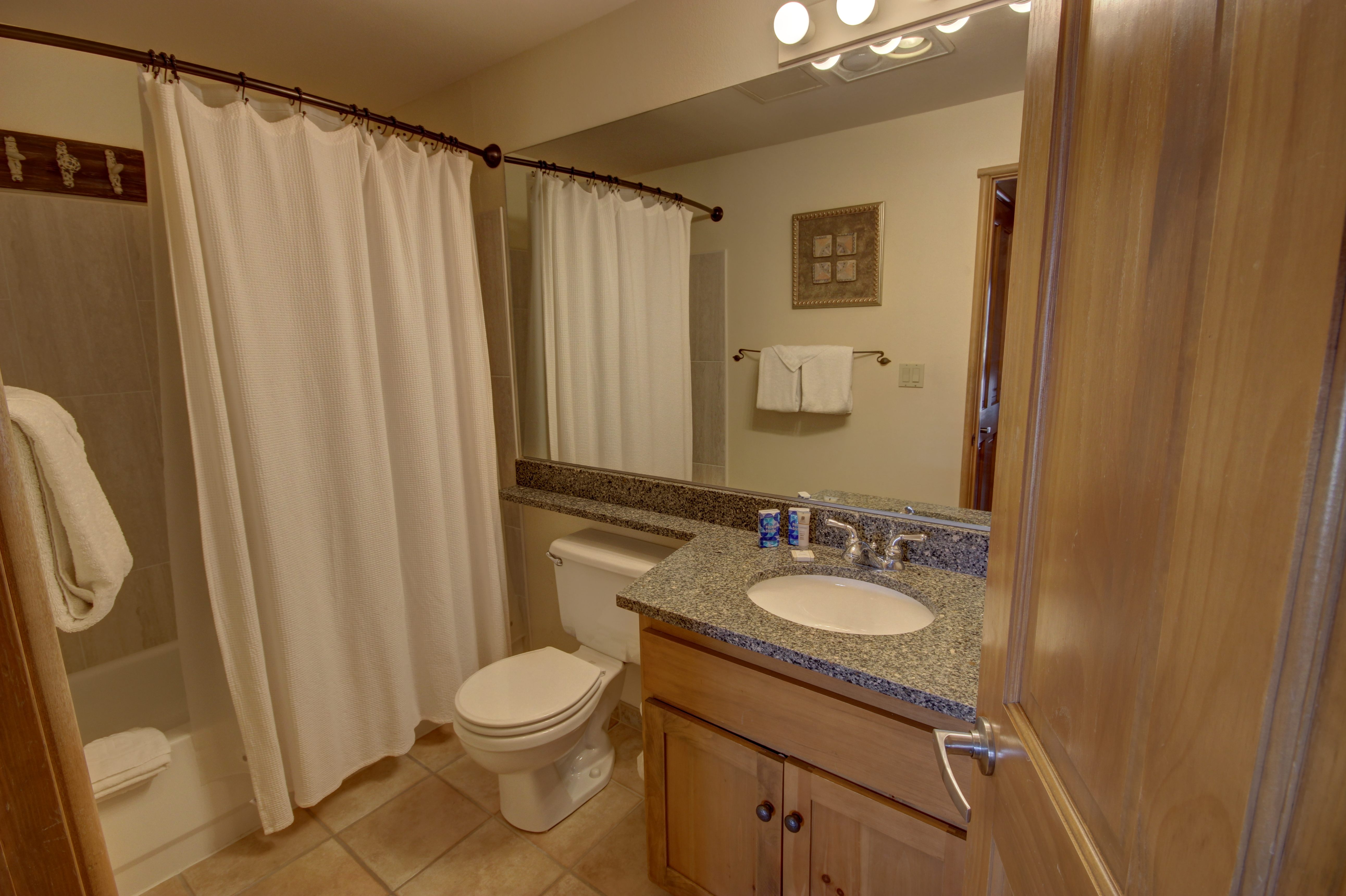Bathroom with a granite counter top