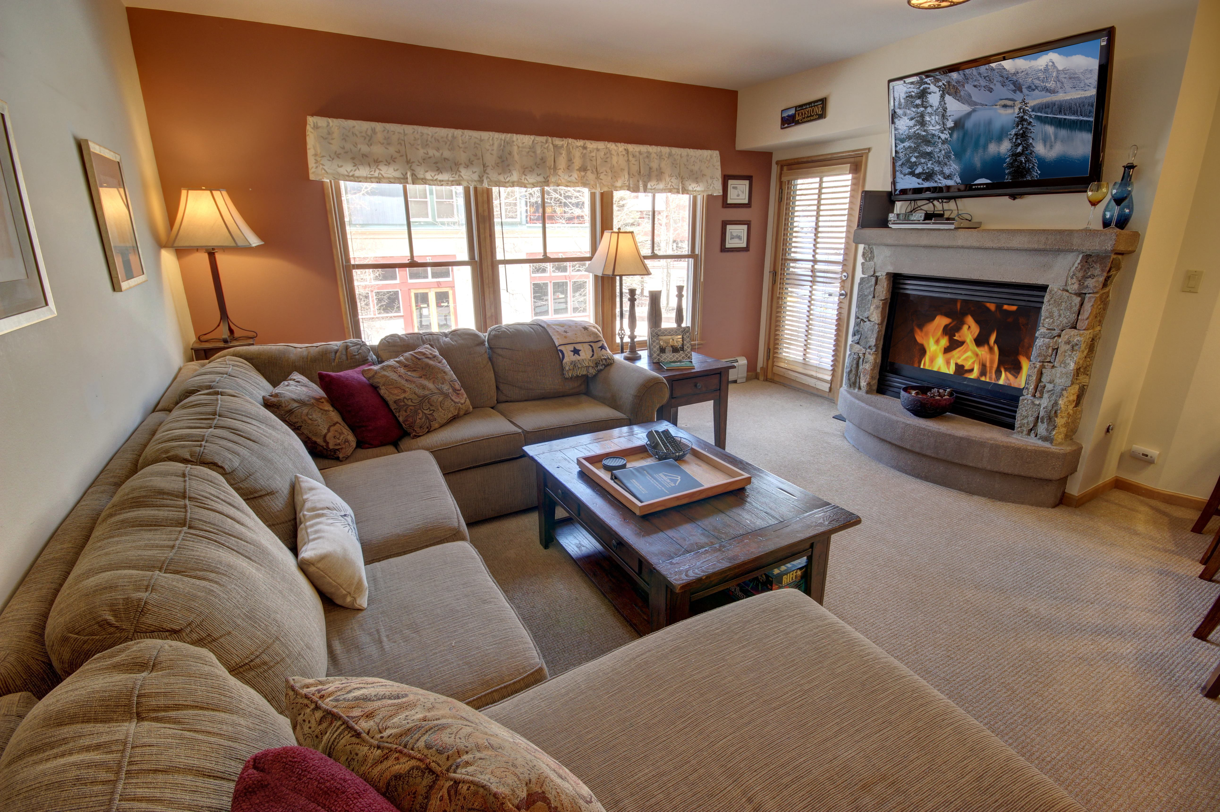 Living room with cozy fireplace and relaxing flat screen TV