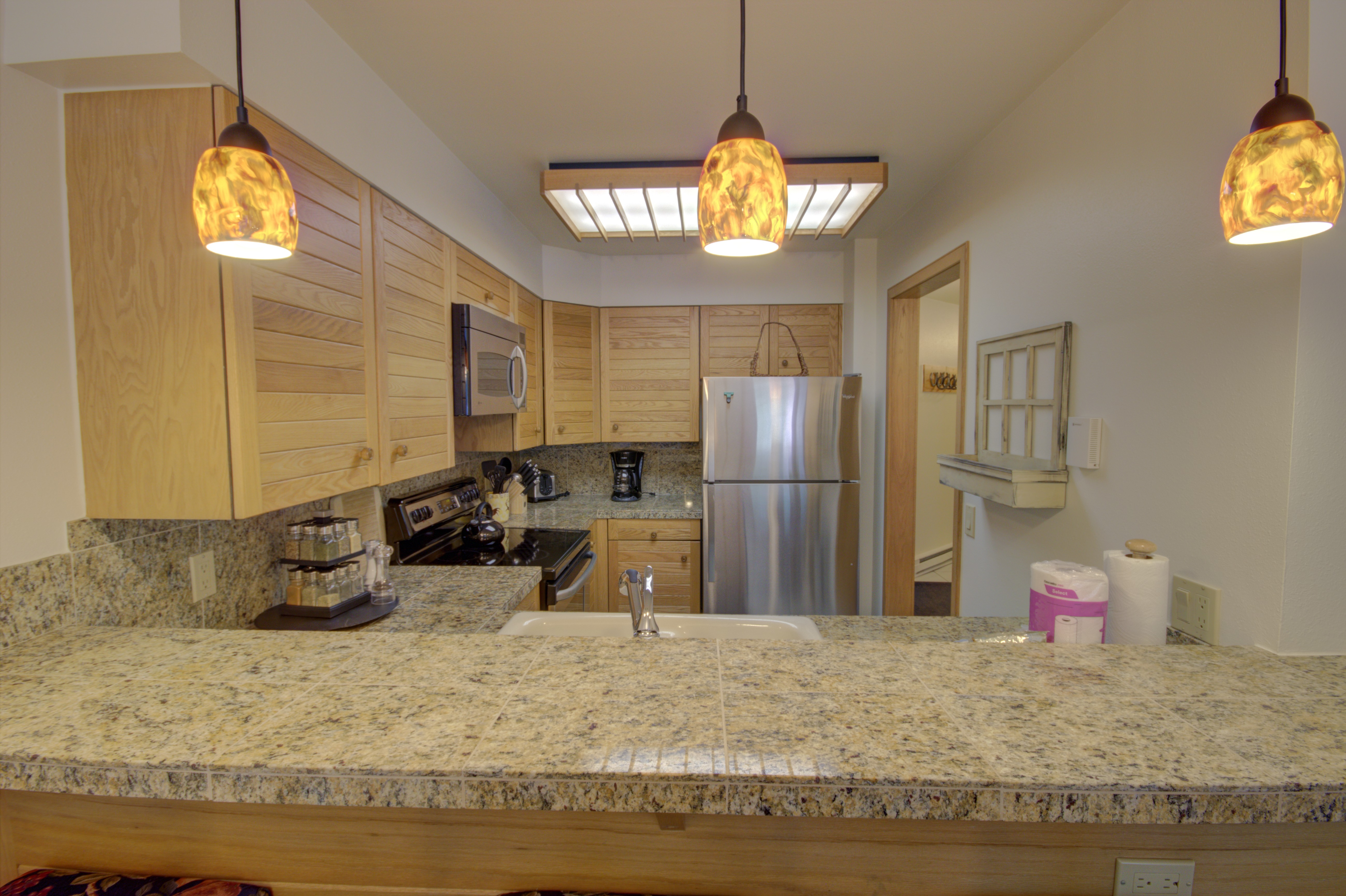 Kitchen with breakfast bar and stainless appliances
