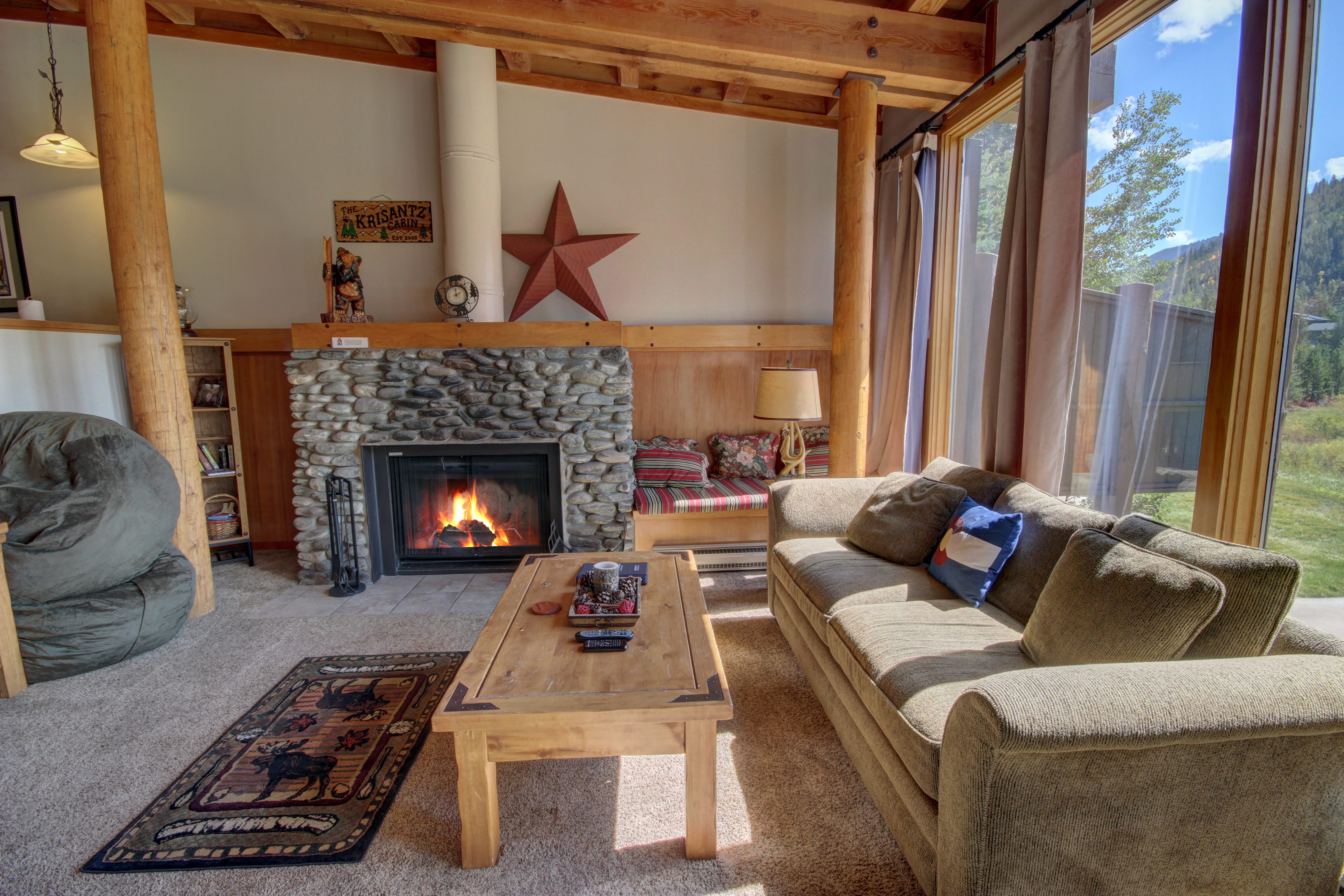 Enjoy relaxing with cozy fireplace and couches