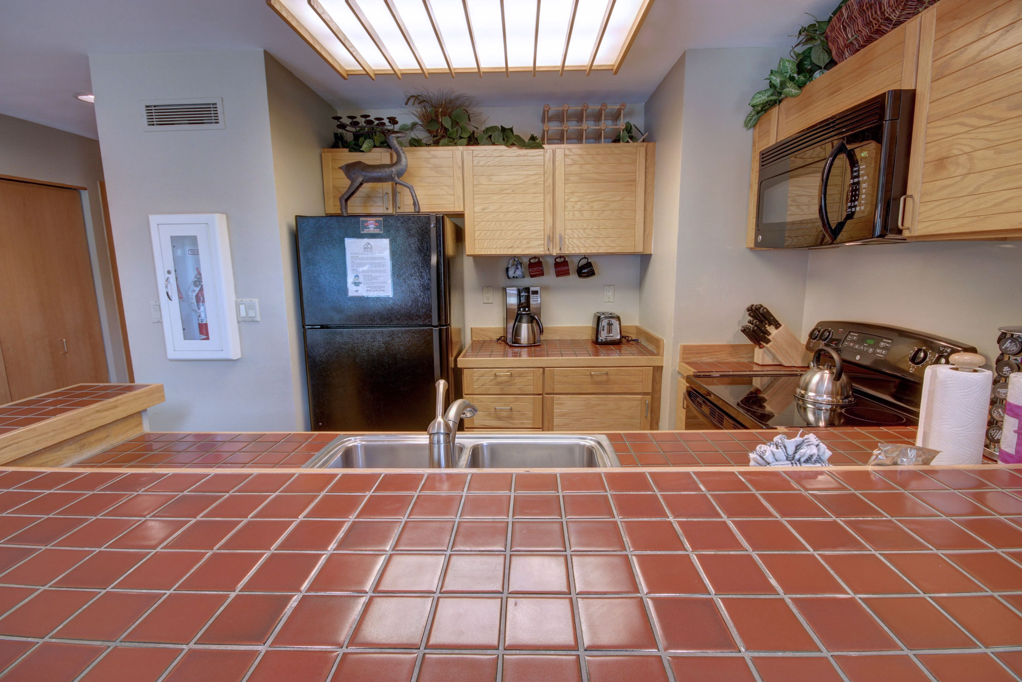 Kitchen with breakfast bar and coffee maker perfect for those early mornings