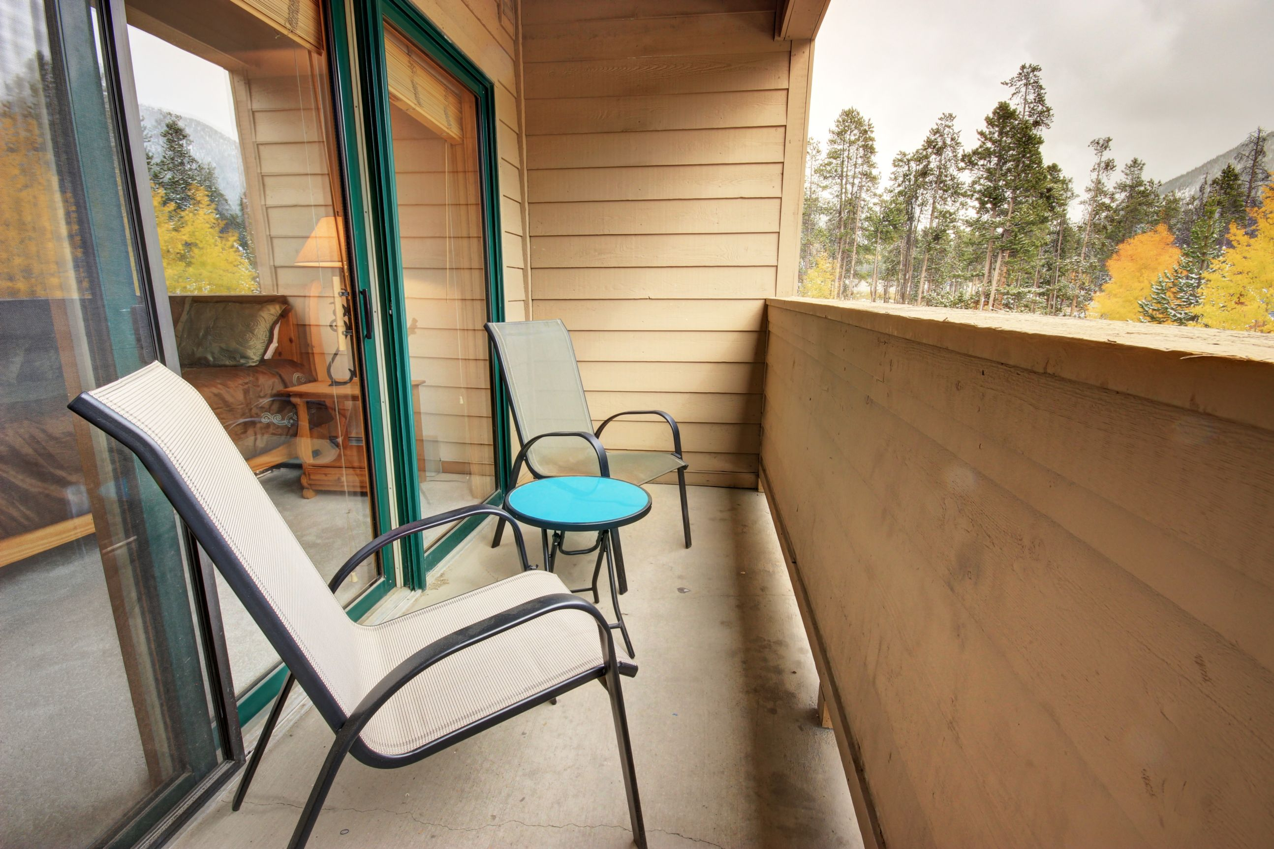 Upper level balcony with outdoor furniture