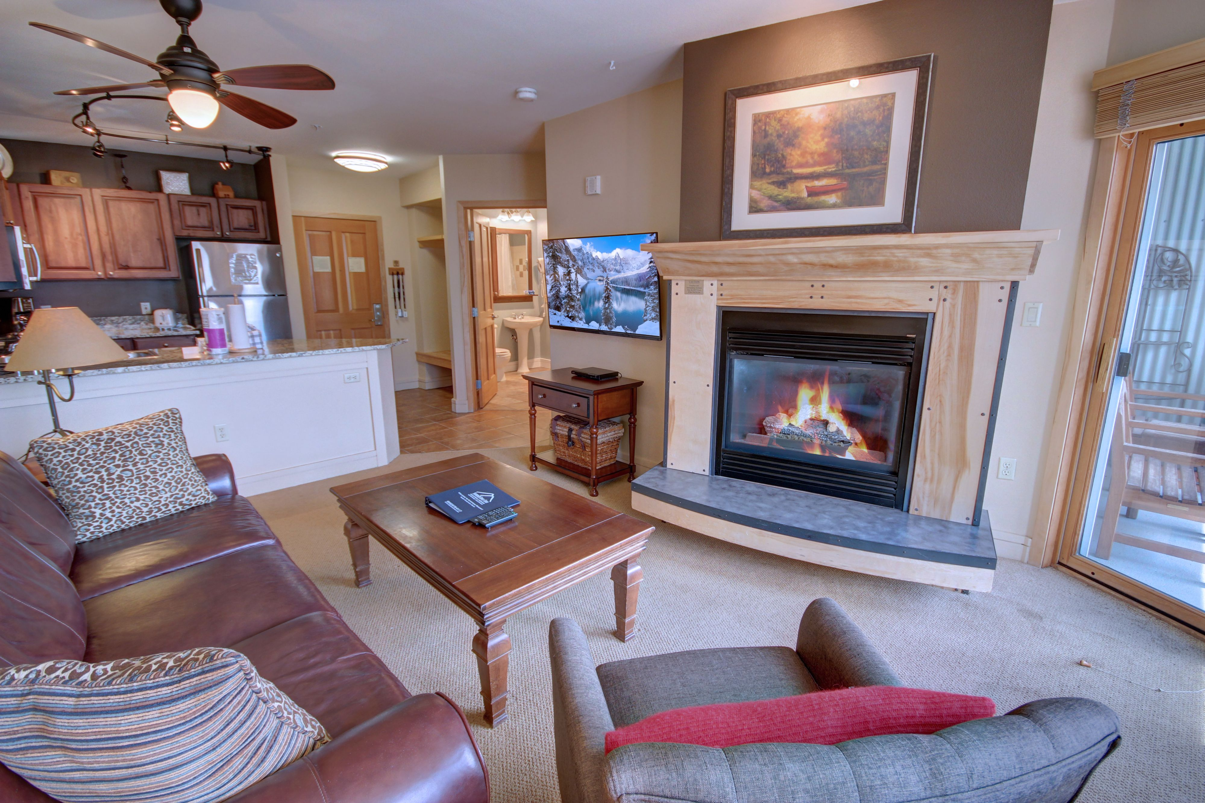Living room with comfortable couch and fire