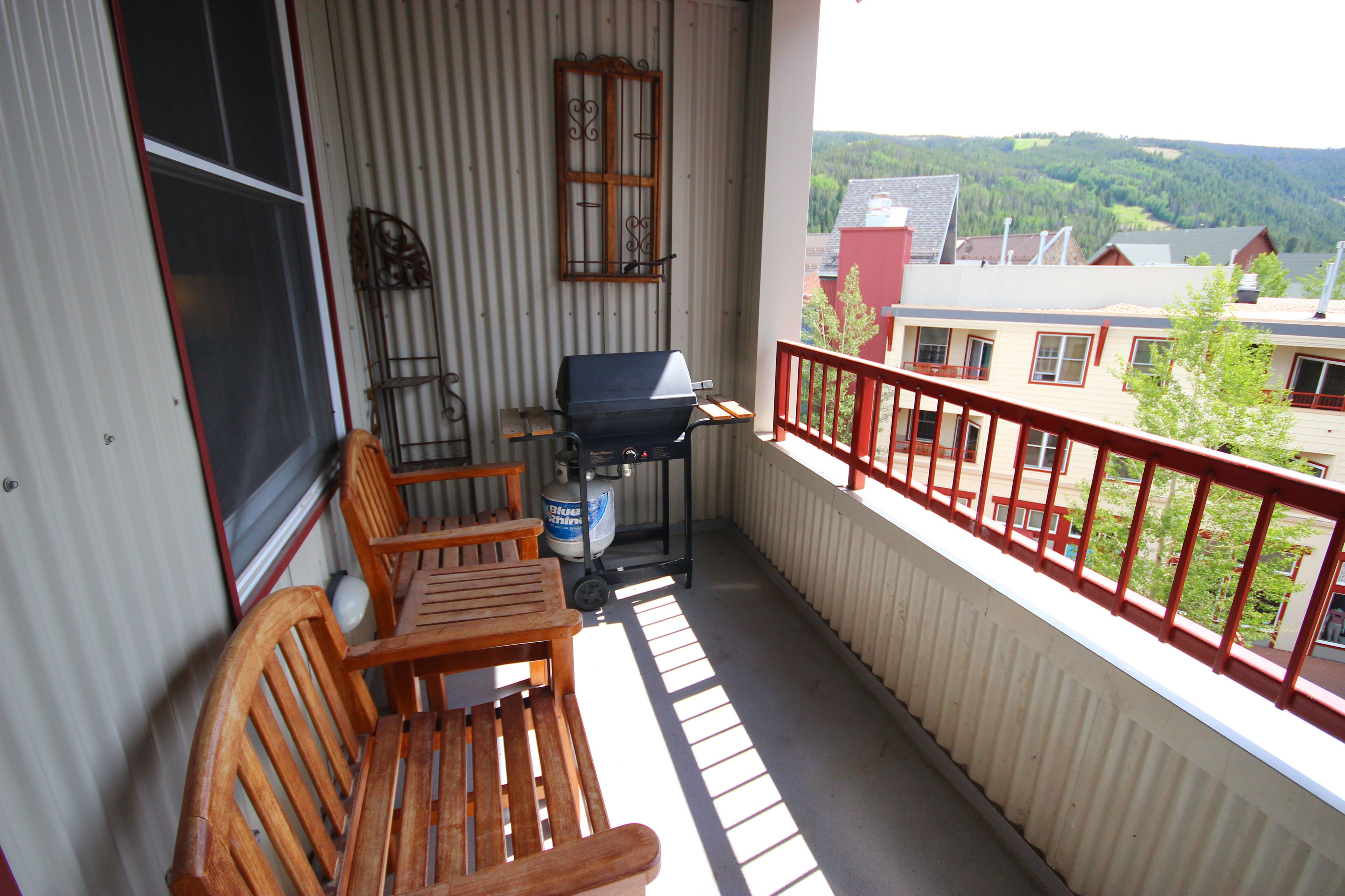 Porch with space for grilling and relaxing