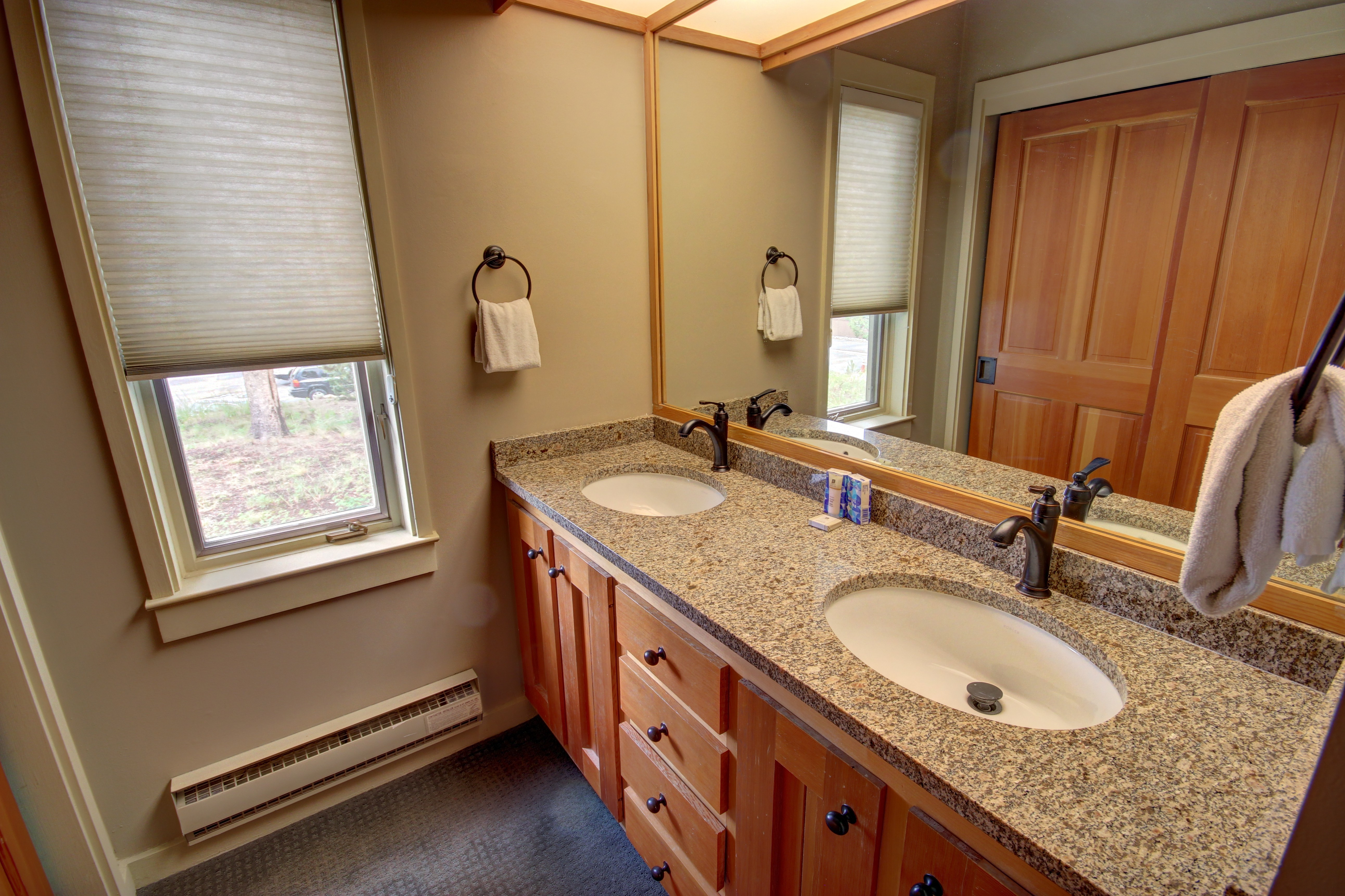 Bathroom with drawers and granite countertops