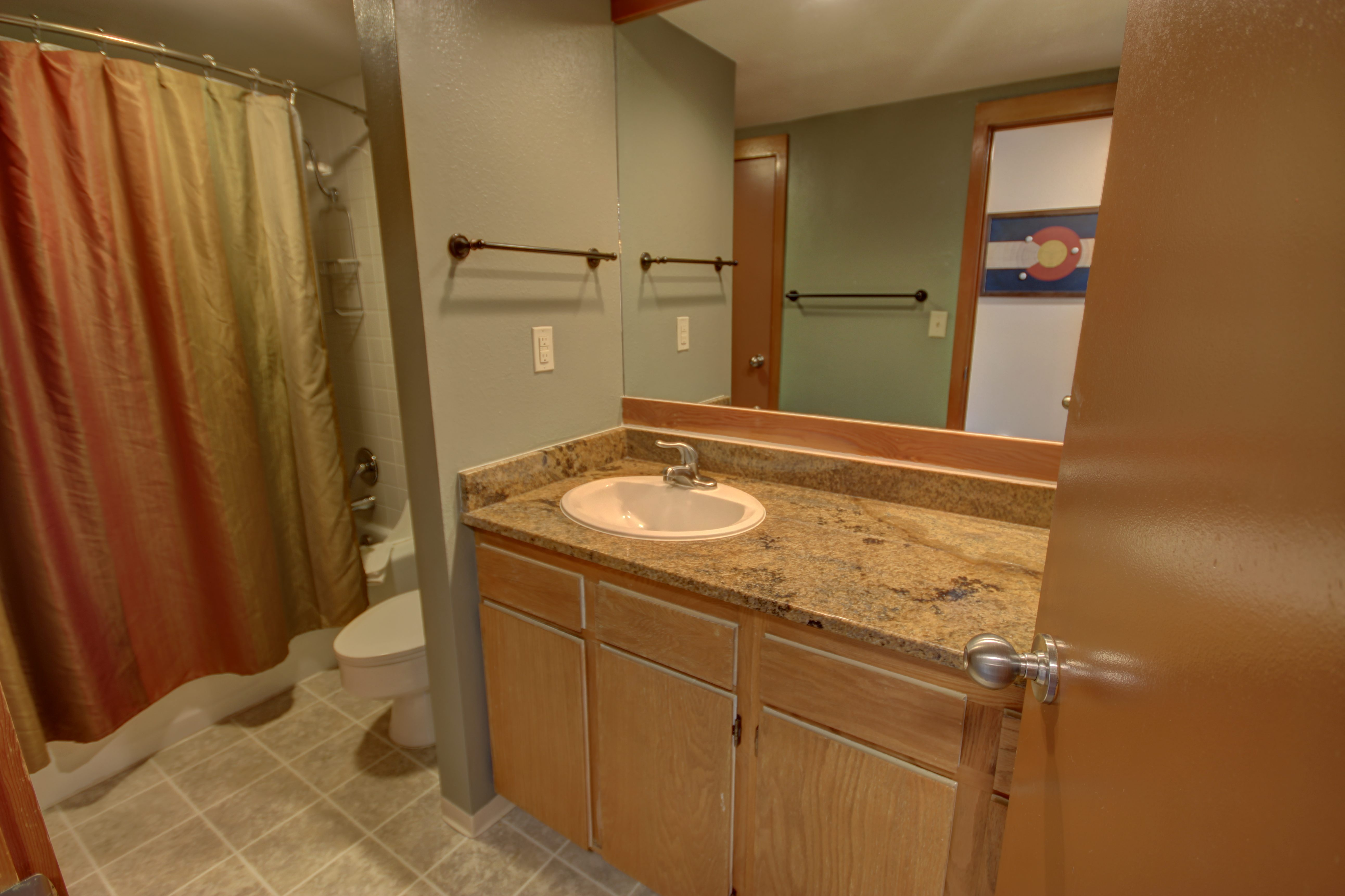 Bathroom with granite counter top