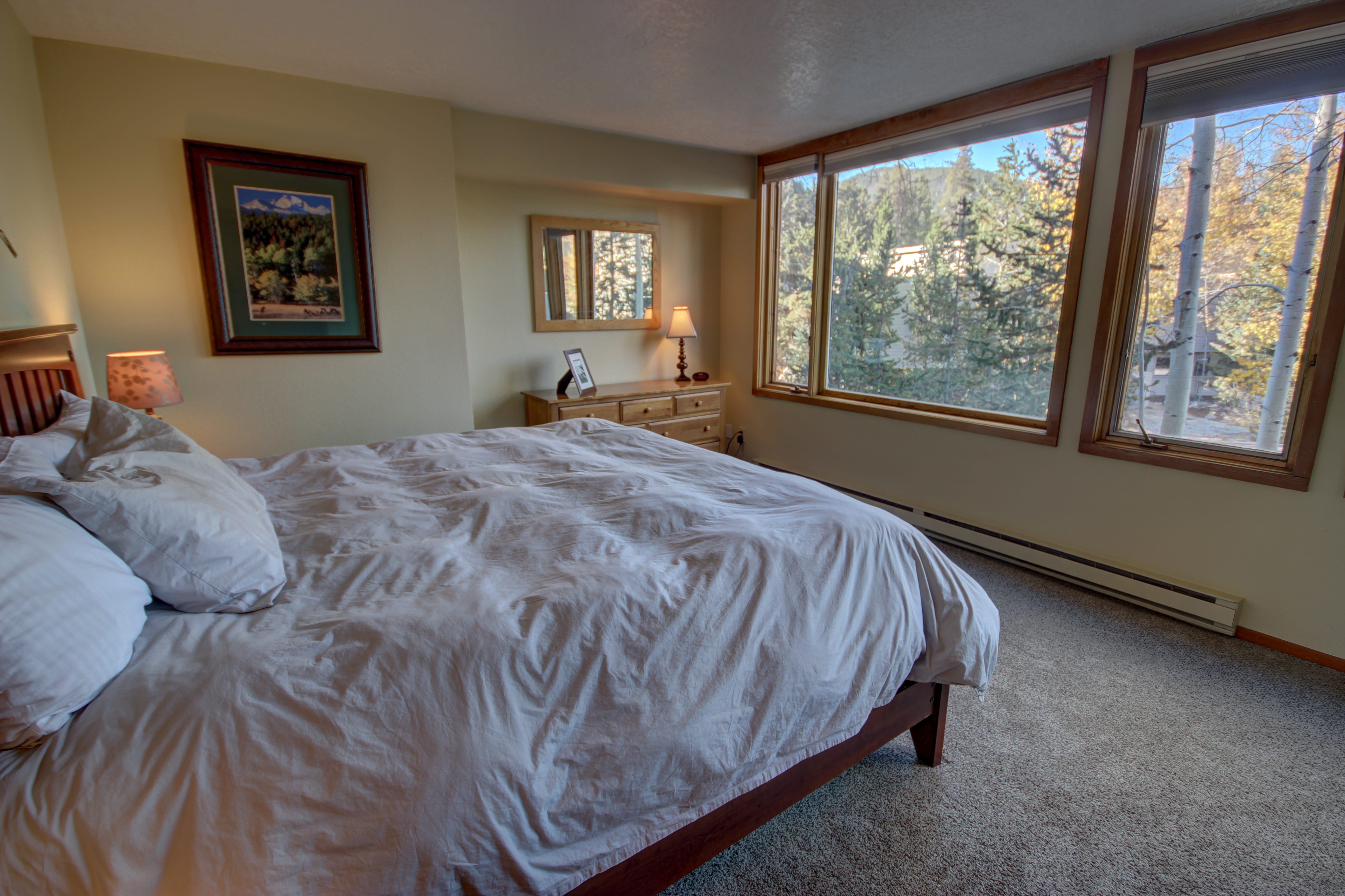 Bedroom with awesome view to enjoy as you relax after a long day in the sun or snow