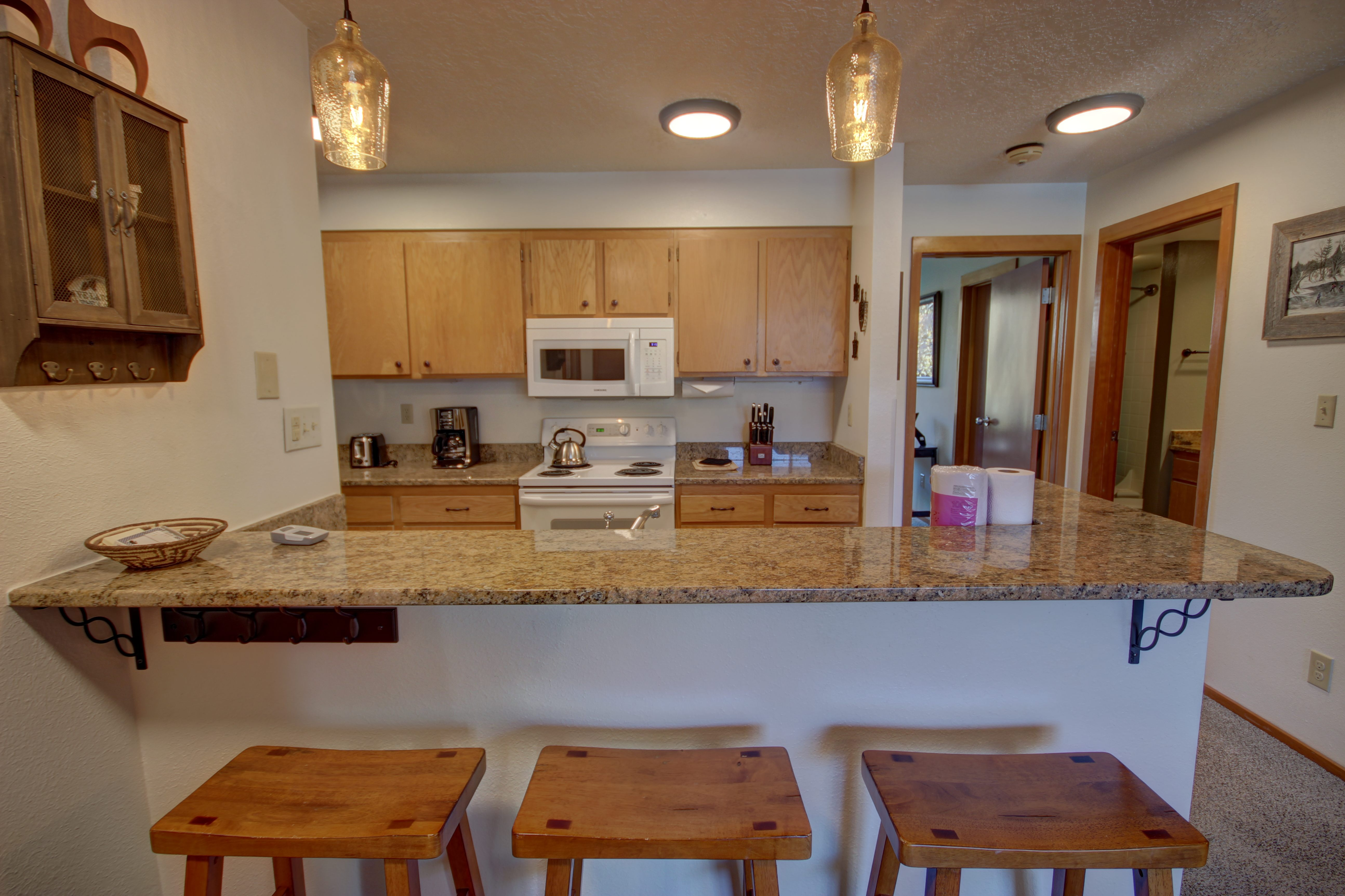 Kitchen with breakfast bar and extra seating perfect for a kids table