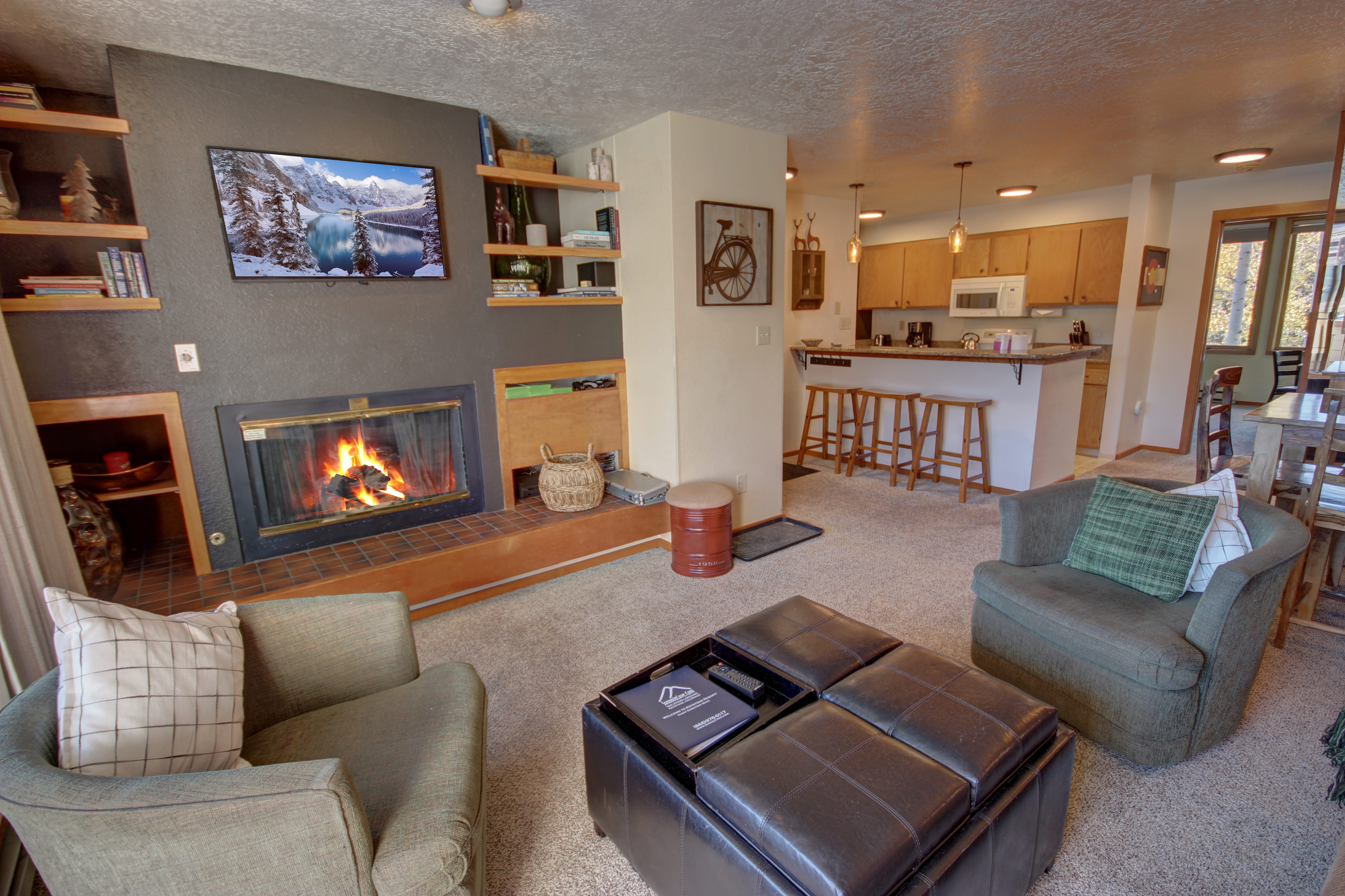 Living room with gas fireplace and flatscreen TV to relax with family by