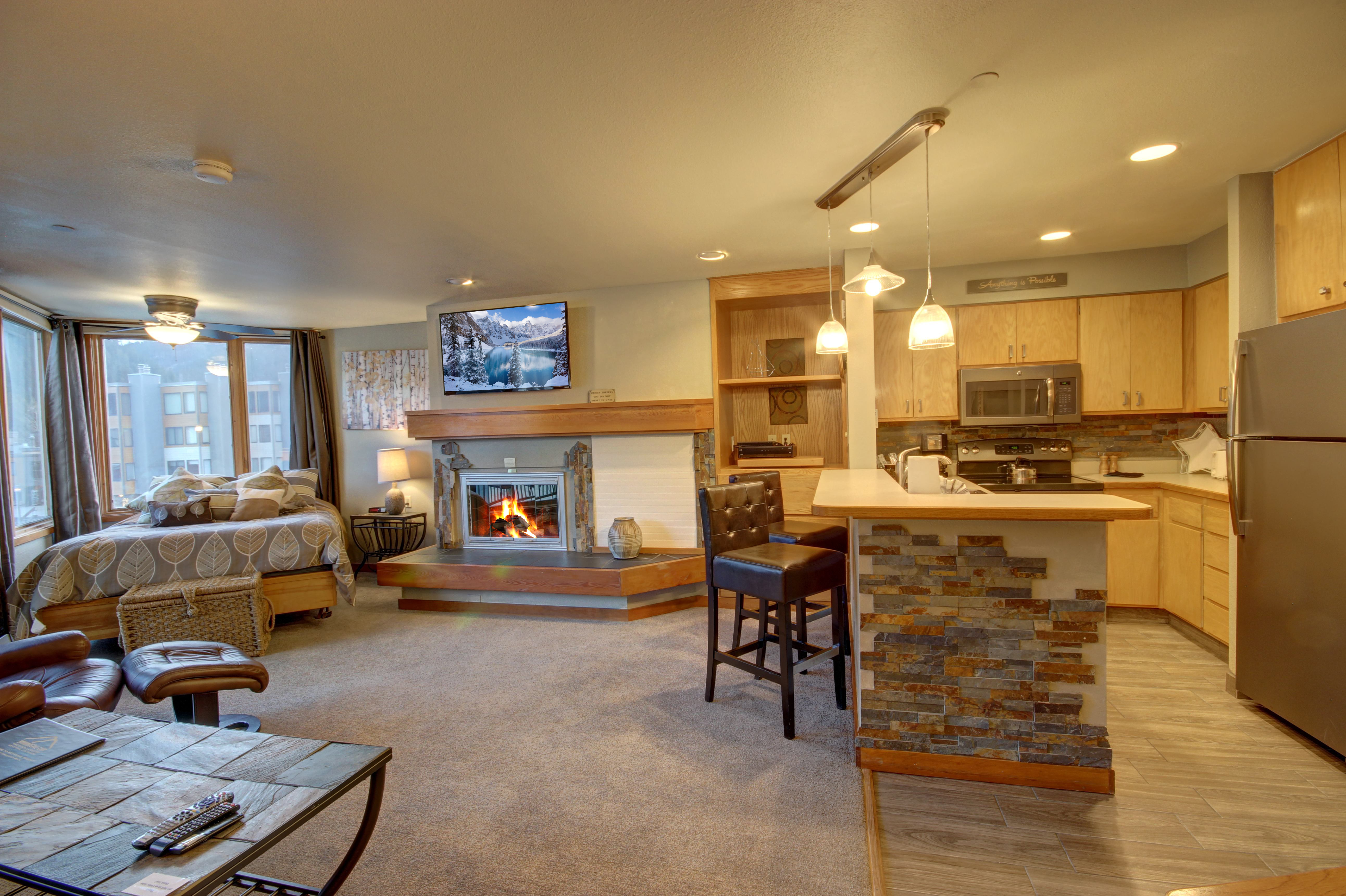 Living room and kitchen with a modern touch, kitchen also includes breakfast bar