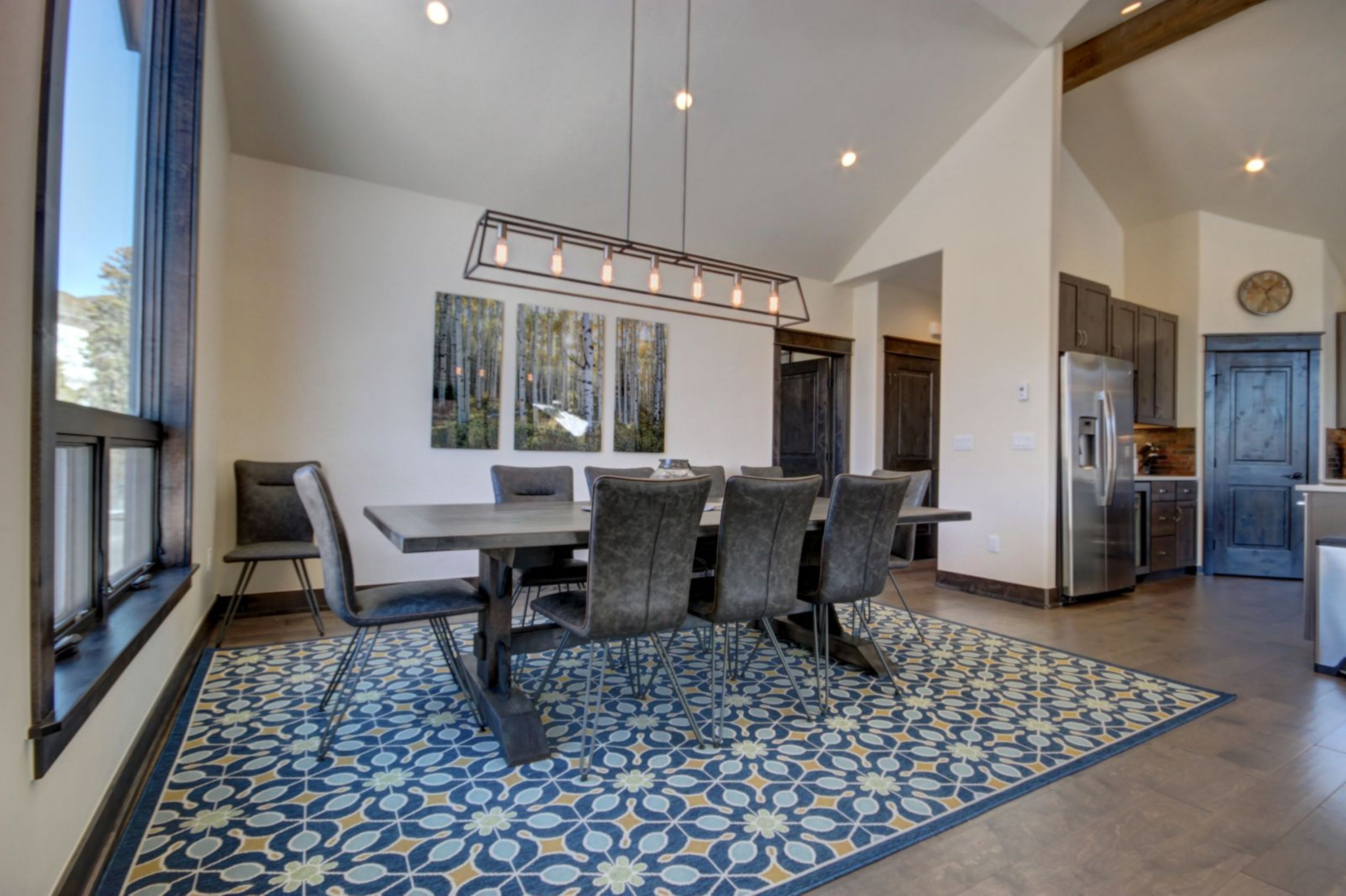 Dining table with colorful carpet