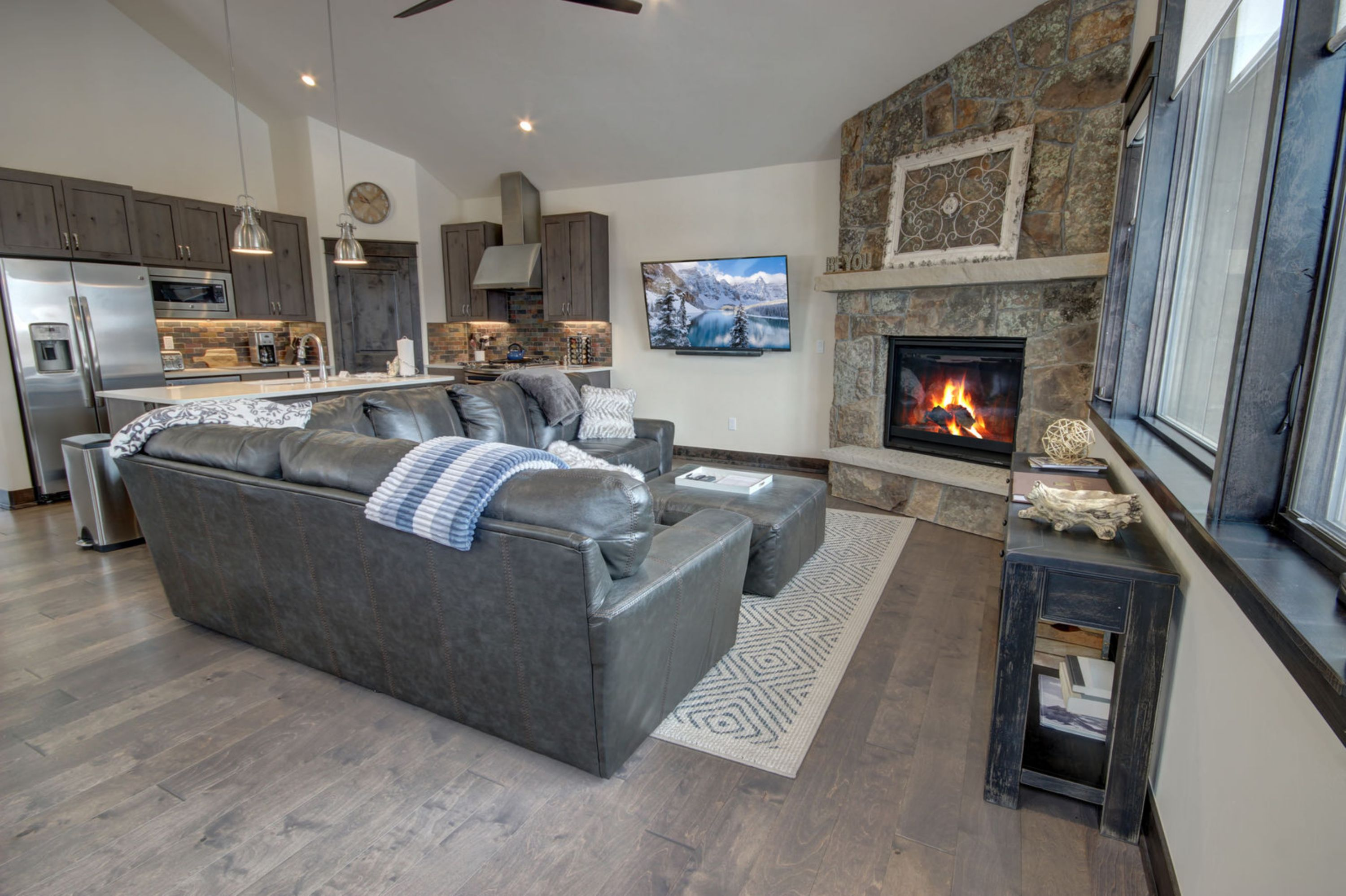living room with a cozy fireplace and relaxing tv