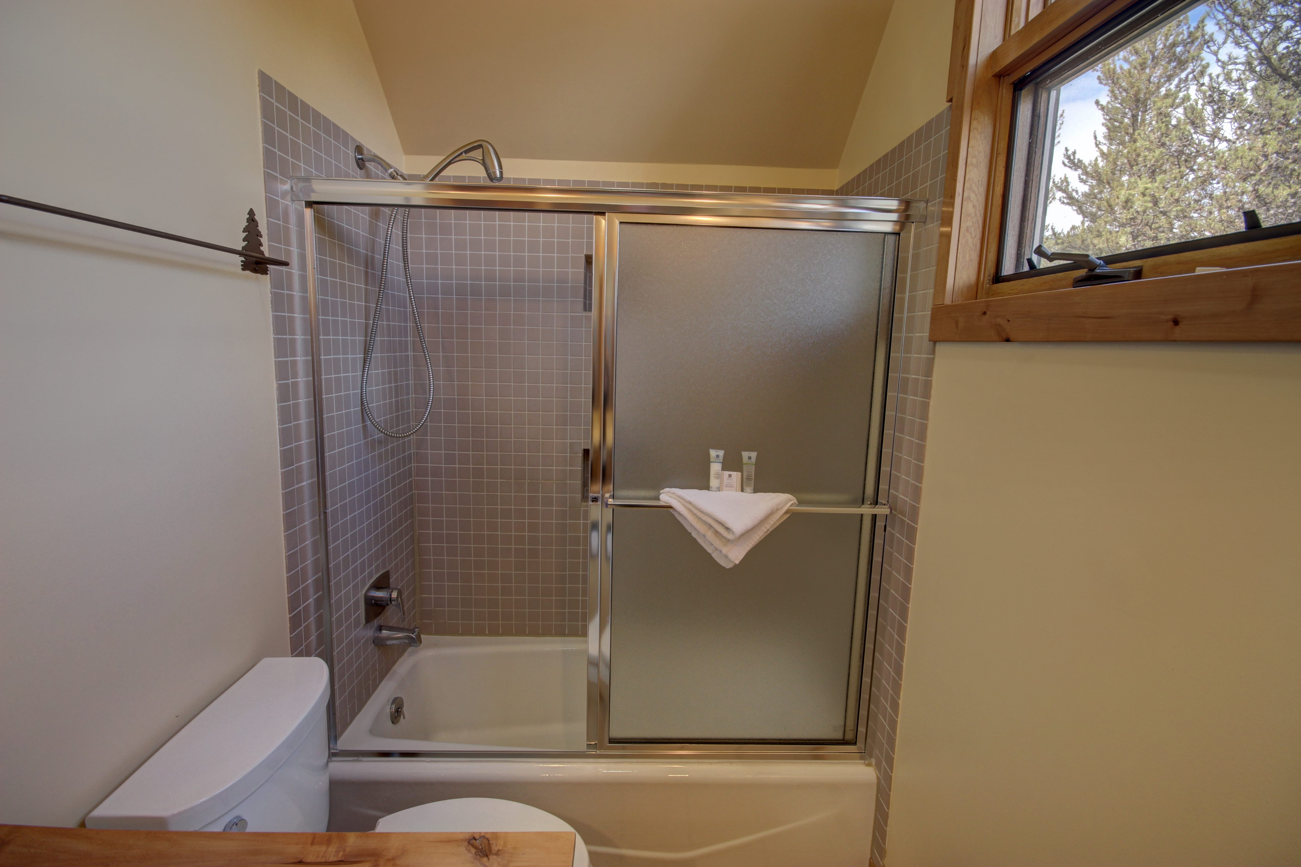 Bathroom with relaxing bath and shower