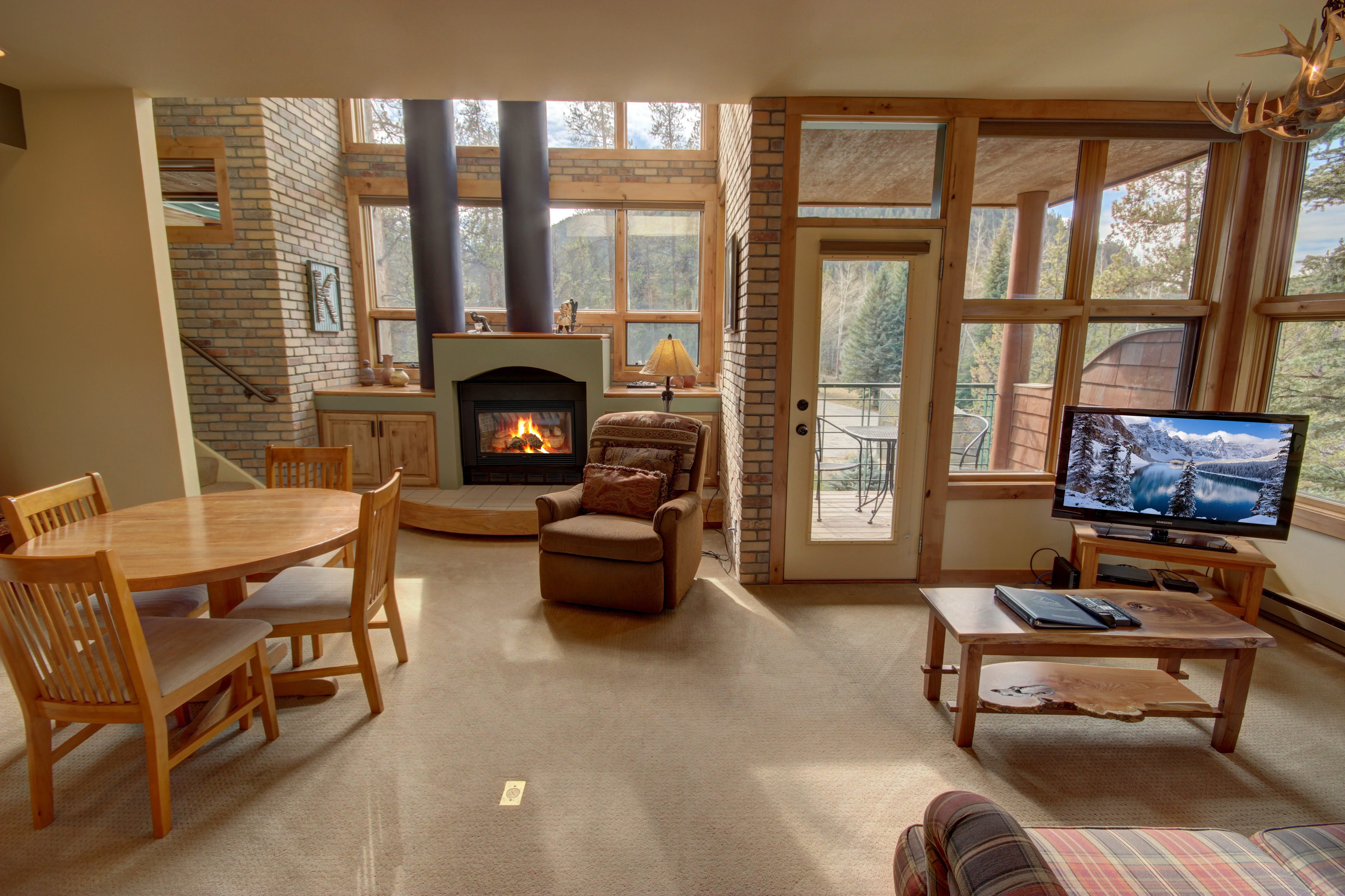 Living room with cozy fireplace and comfy couches