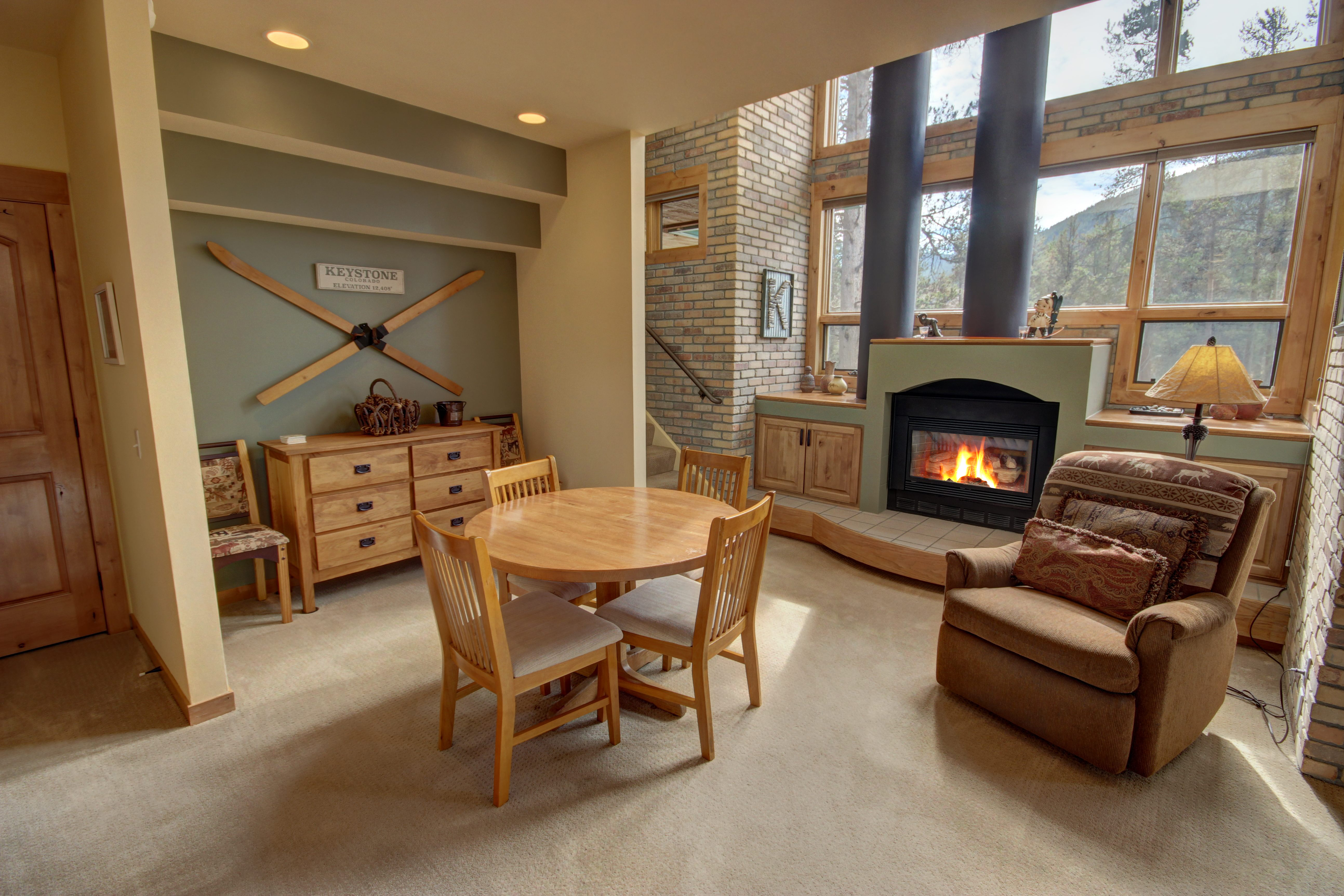 Living room with dining and cozy fire