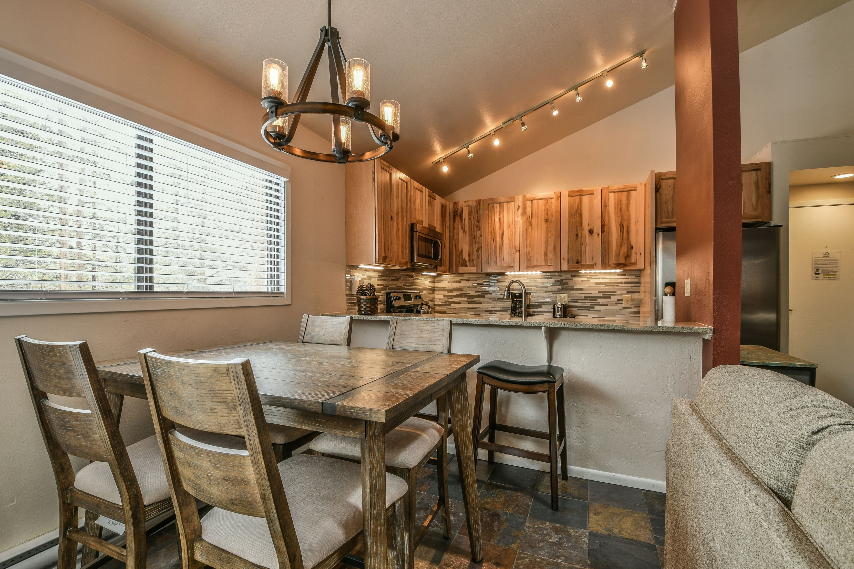 Dining room with stainless wooden table to enjoy meals