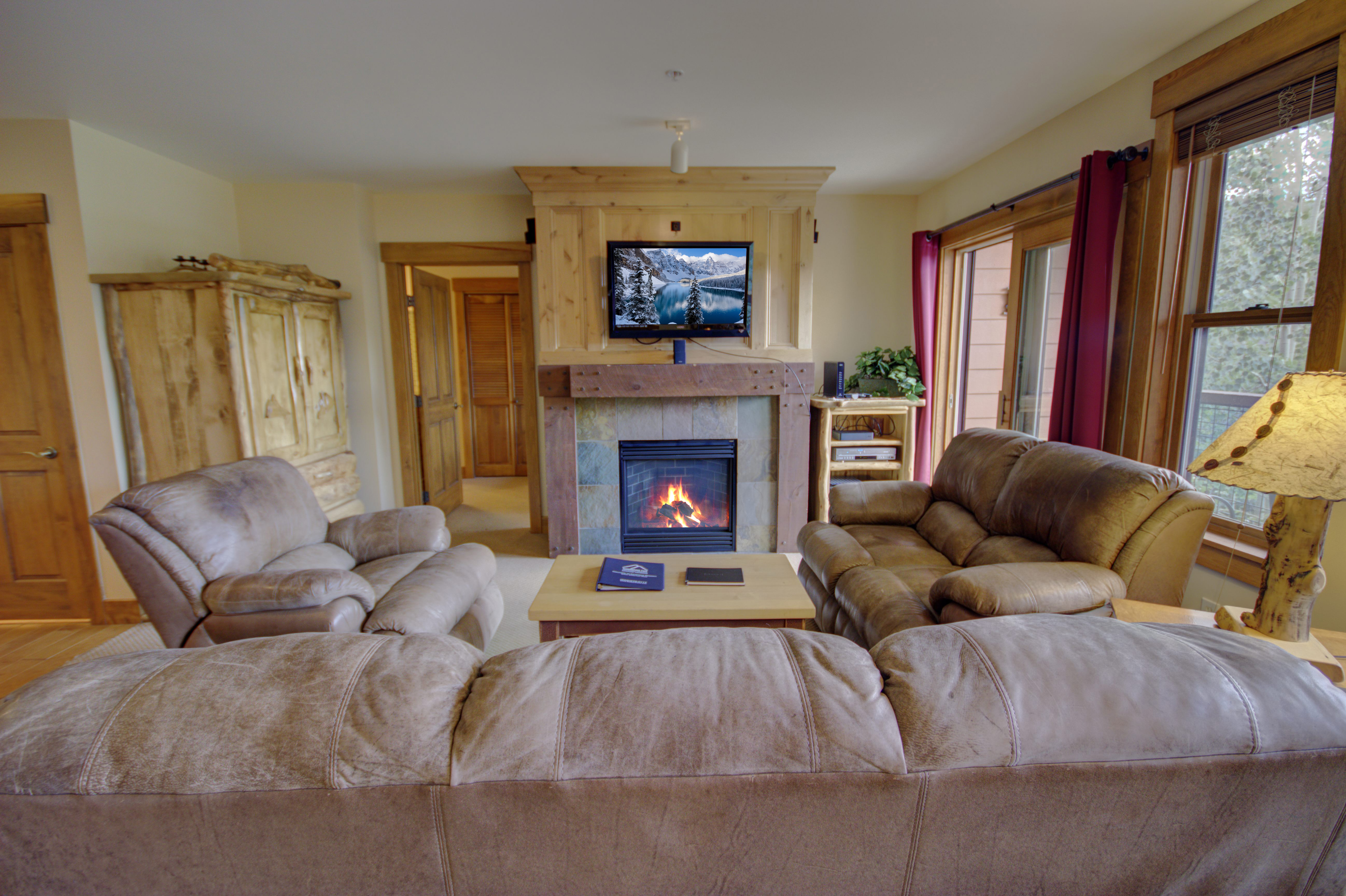 The living room has a TV and a fireplace for cold days