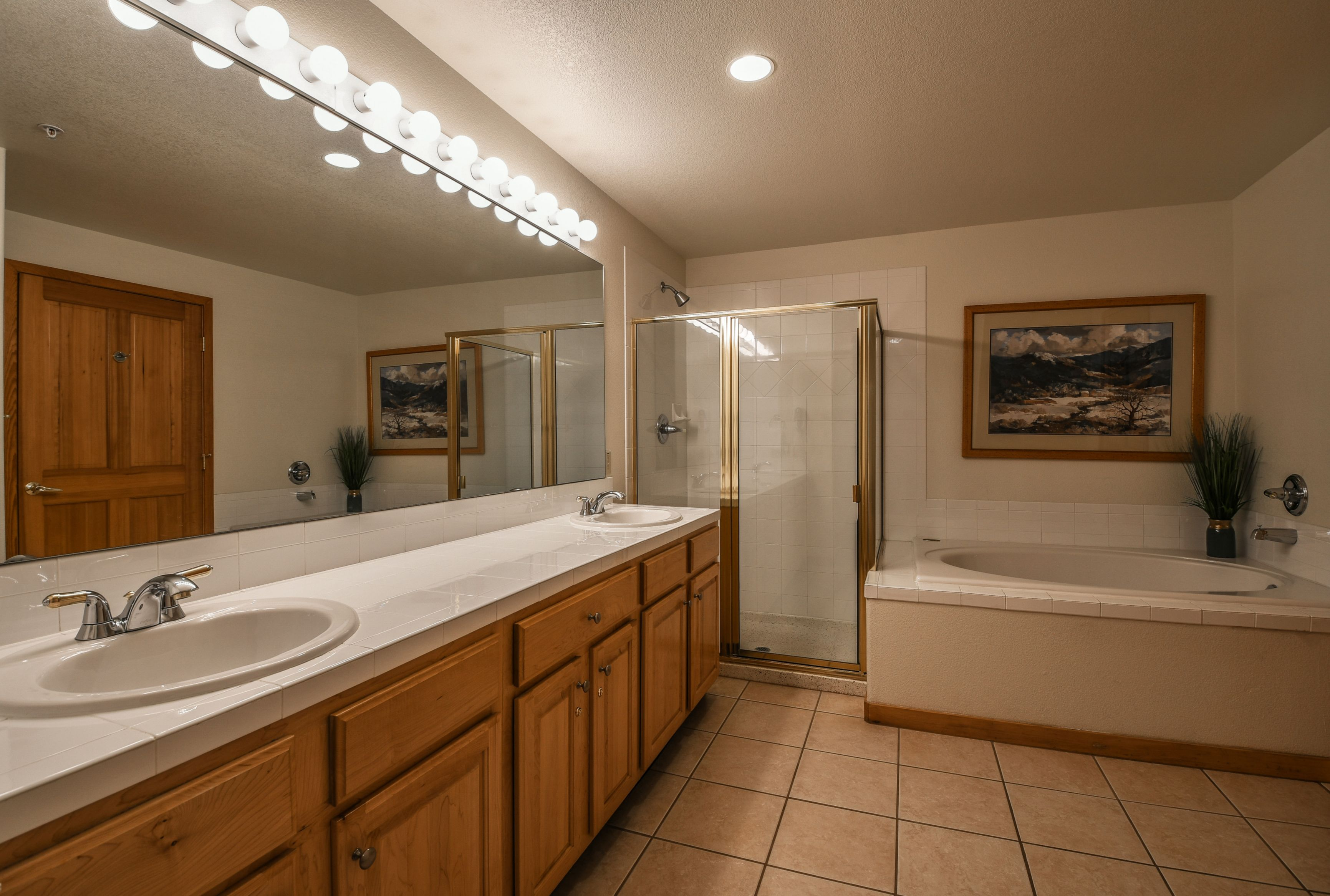 Bathroom with duo sinks and walk in shower