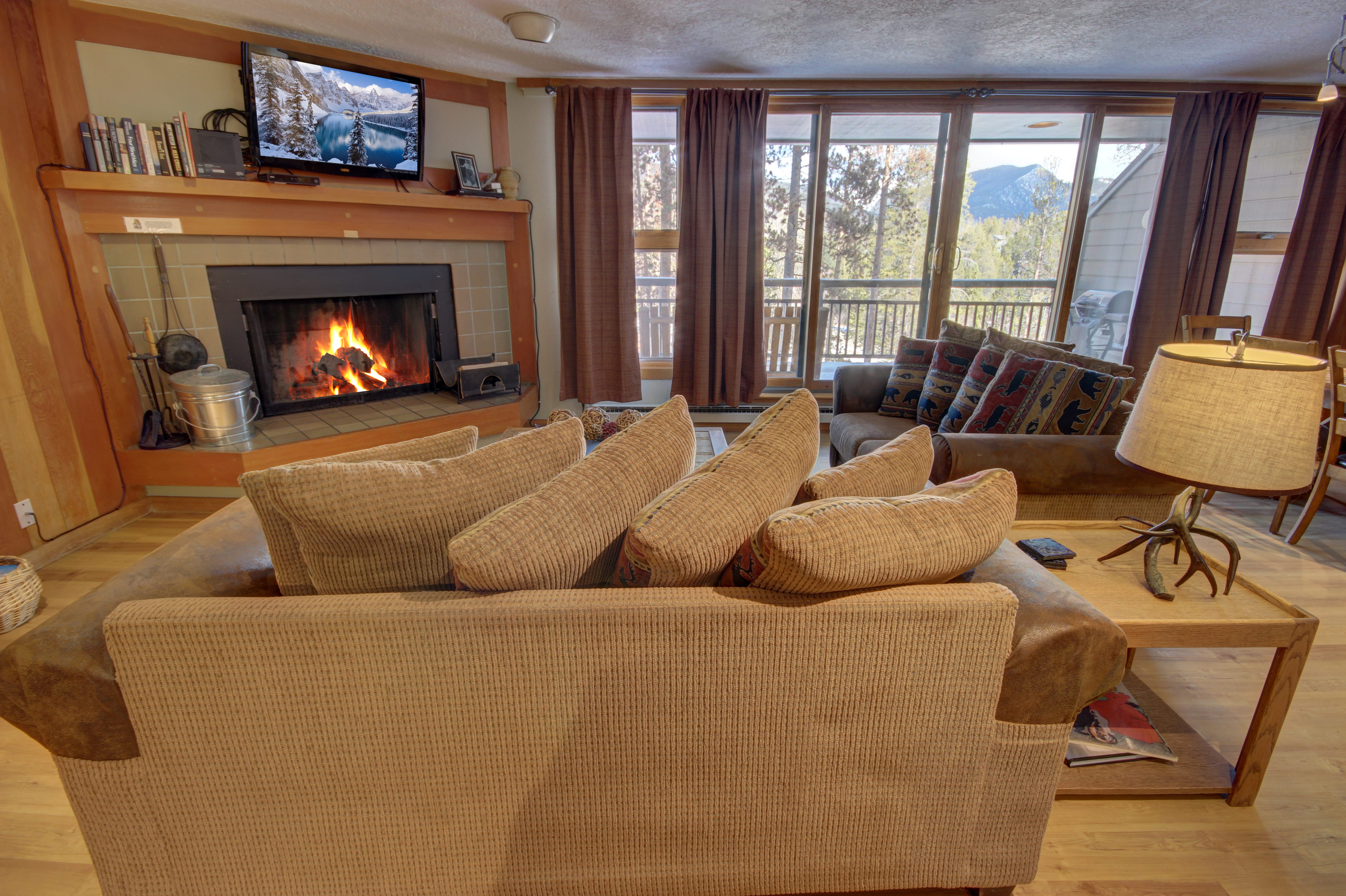 Living room with comfy couches and cozy fireplaces