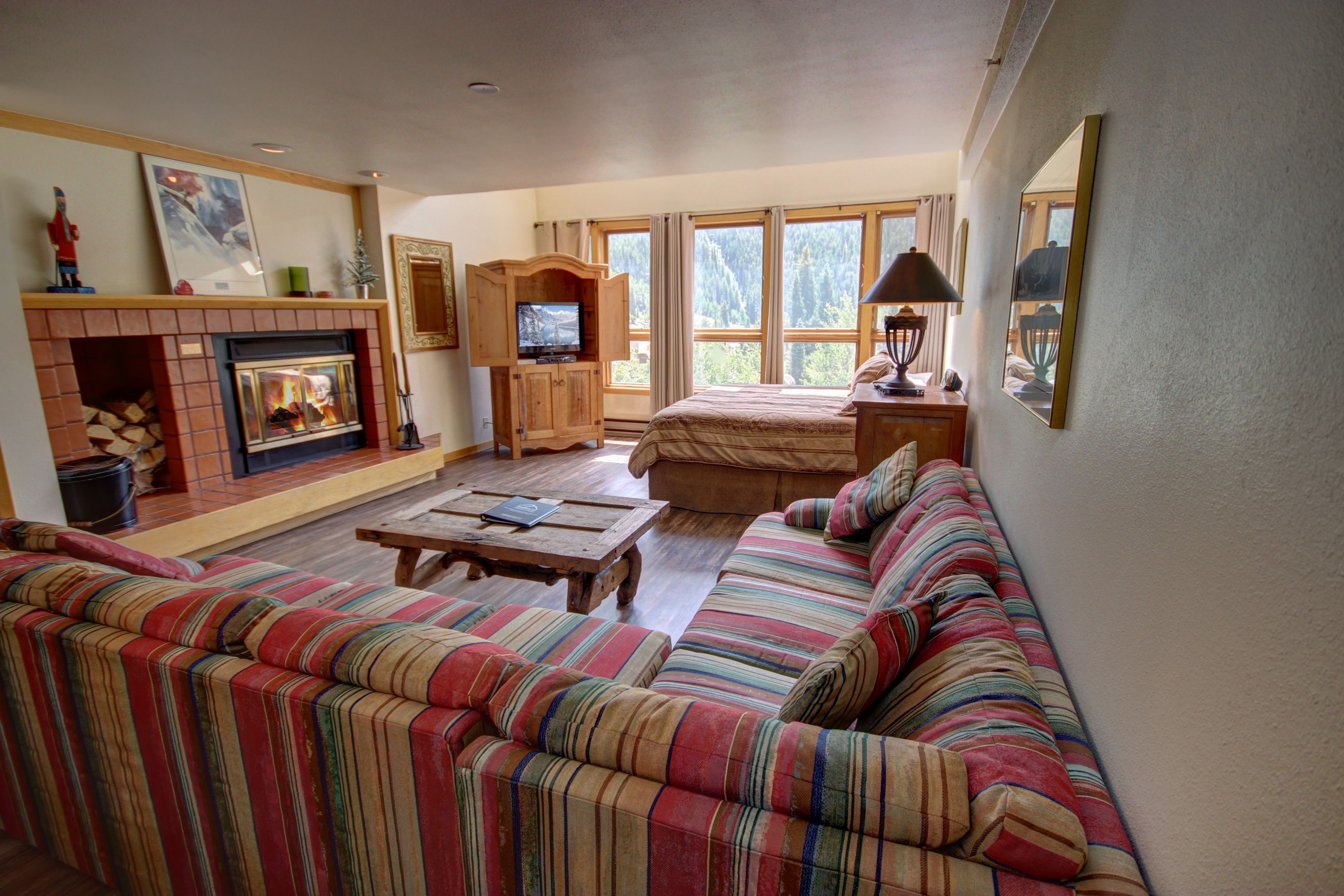 Living room with cozy fireplace and flatscreen TV